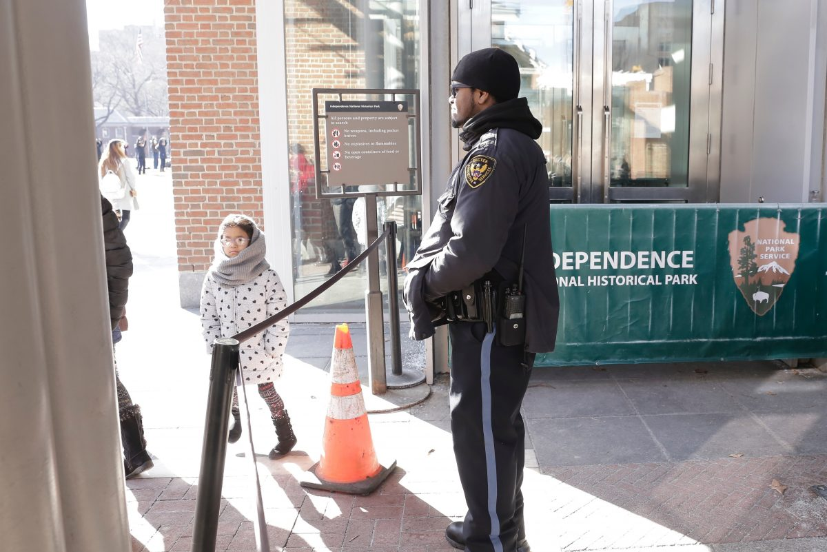 A security guard at the Liberty Bell Center  had to explain to disappointed visitors Saturday that the building is closed due to the government shutdown. ELIZABETH ROBERTSON / Staff Photographer