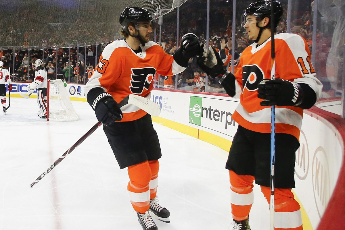 Flyers center Travis Konecny celebrates his first-period goal with teammate defenseman Shayne Gostisbehere against the New Jersey Devils on Saturday, January 20, 2018 in Philadelphia. YONG KIM / Staff Photographer