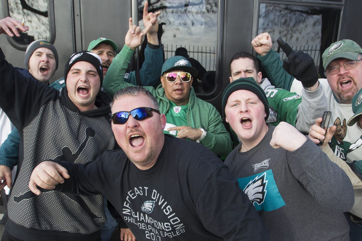 Eagles fans sing the fight song as they wait in line to enter the parking lot for an early morning tailgate party at Lincoln Financial Field. JOSE F. MORENO