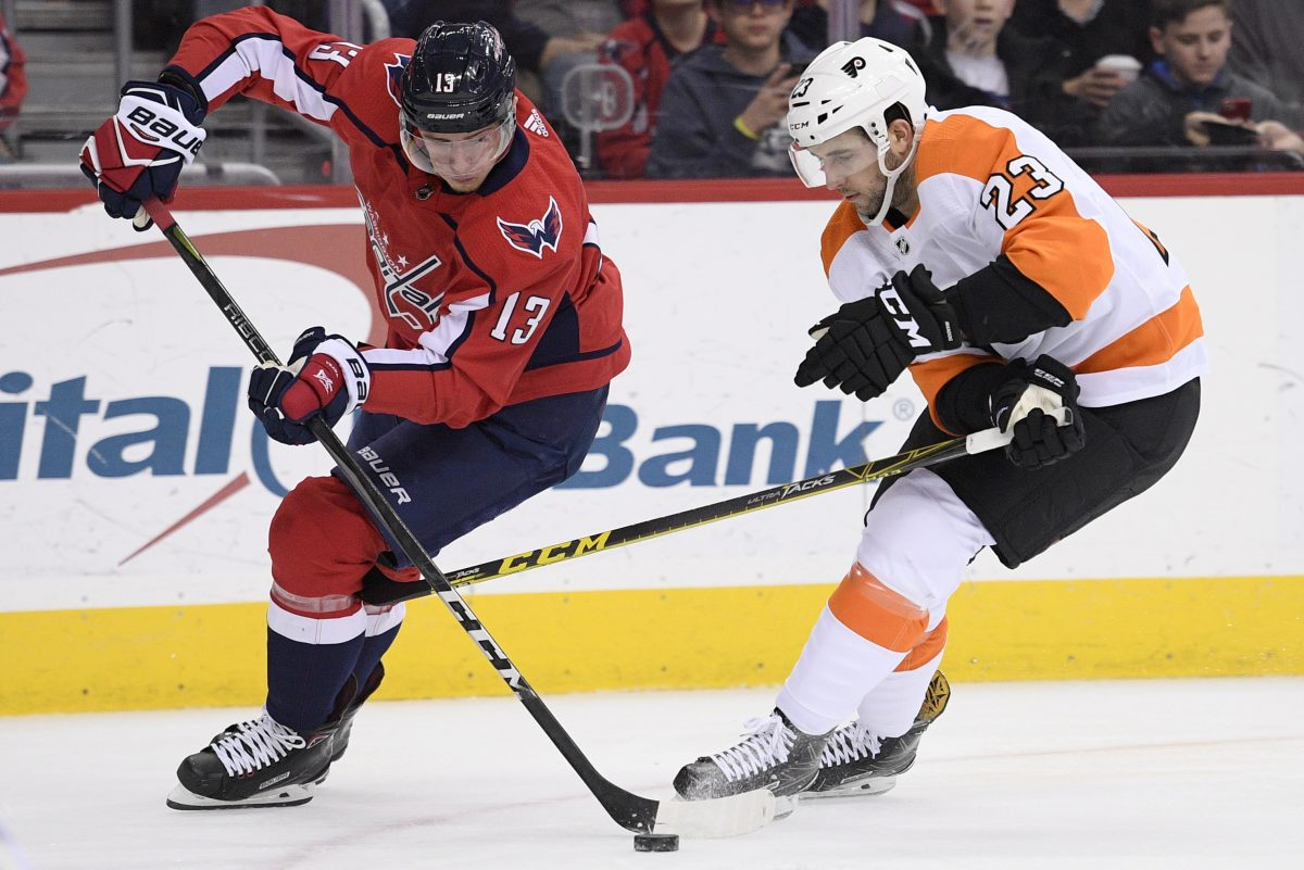 Philadelphia Flyers defenseman Brandon Manning (23) battles for the puck against Washington Capitals left wing Jakub Vrana (13) during the second period of the Flyers´ 2-1 overtime win.