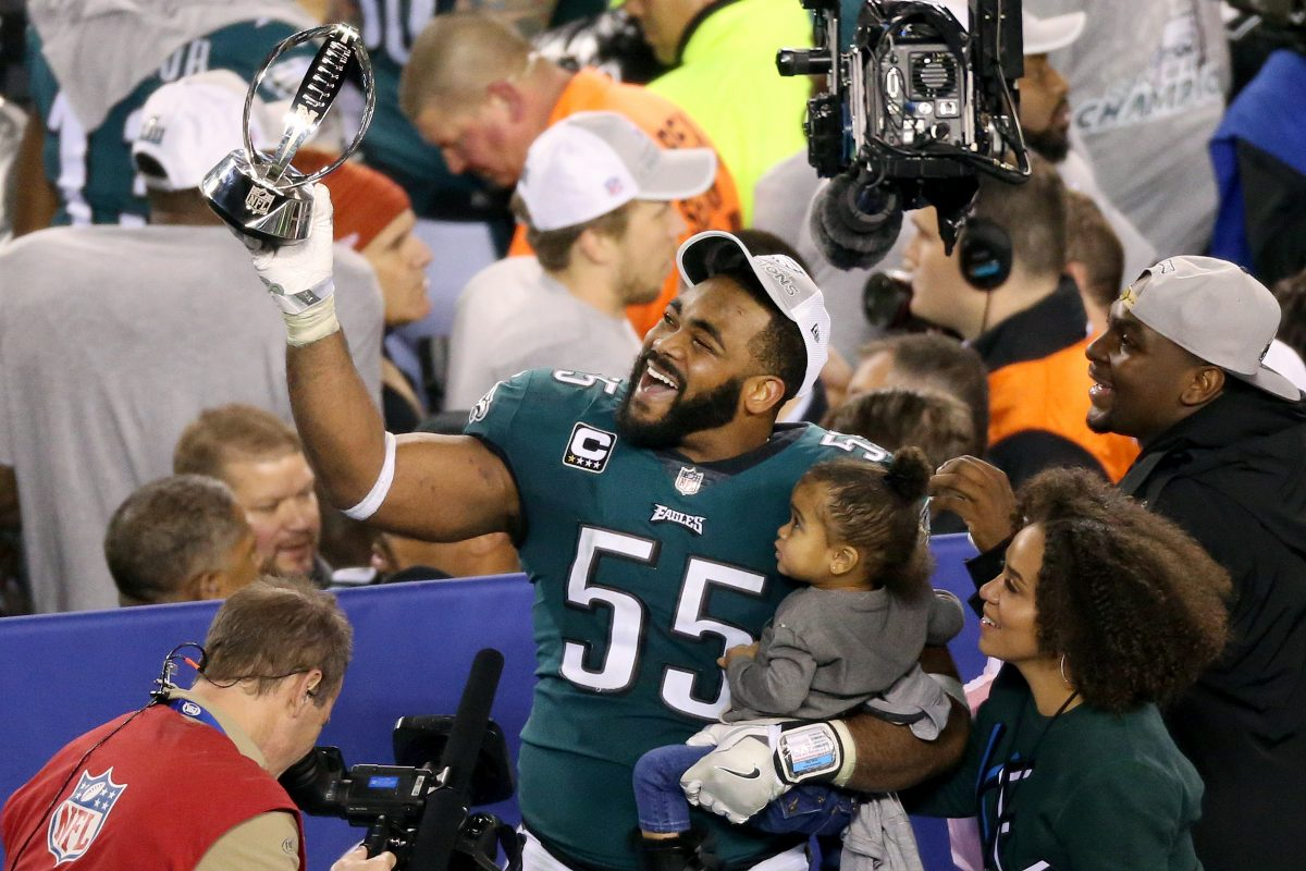Eagles defensive end Brandon Graham celebrates with the trophy after the NFC championship game at Lincoln Financial Field on Sunday, Jan. 21, 2018. The Eagles won 38-7.