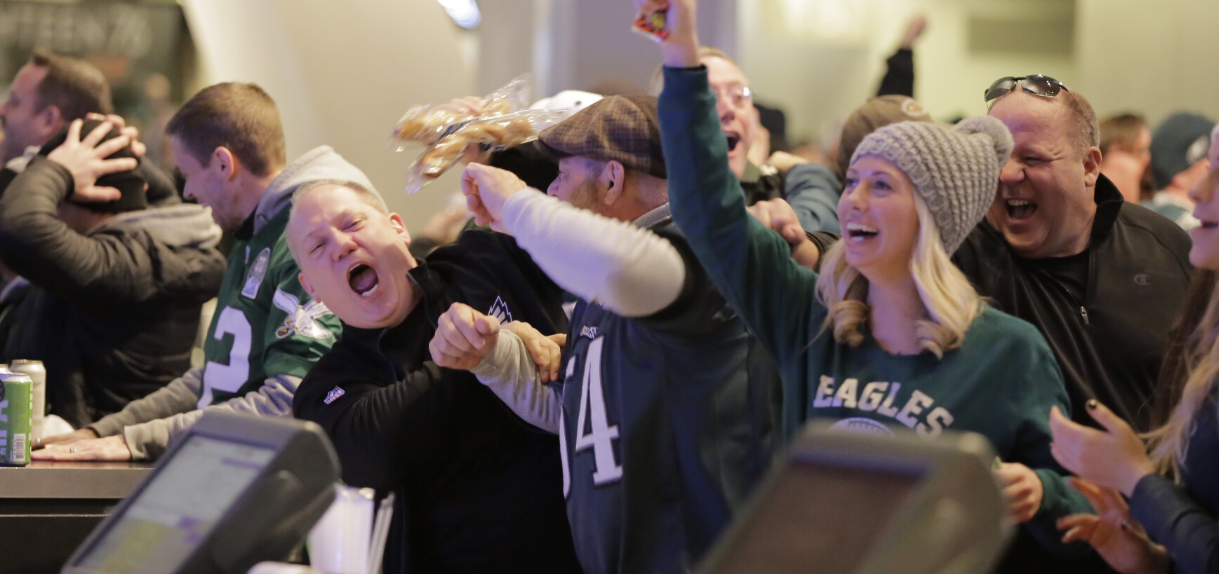 Eagles fans celebrate in the Panasonic Club during the NFC championship game at Lincoln Financial Field.