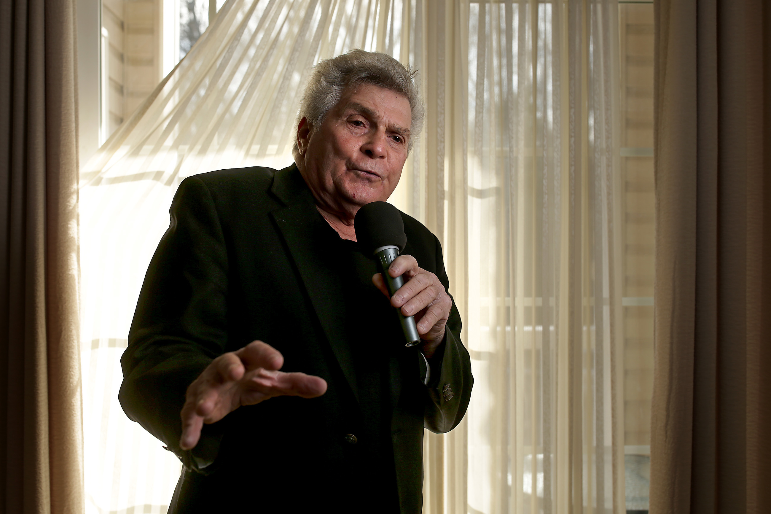 """Frank Hartman, 81, stopped singing for nearly 30 years but resumed his career in 1997. """"I´m one of the only entertainers I know who brings along his own stage,"""" he says."""