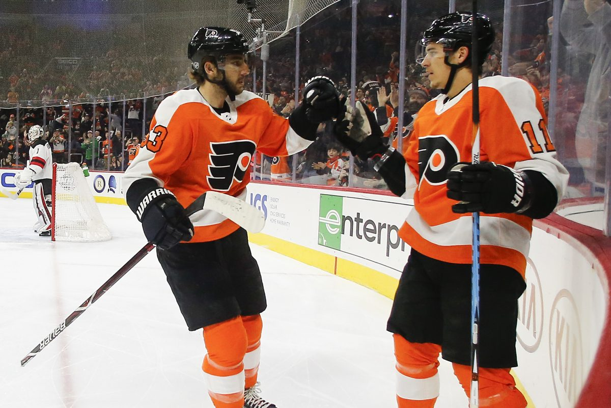 Travis Konecny (right) celebrating his first-period goal with Shayne Gostisbehere in Saturday's 3-1 win over New Jersey.