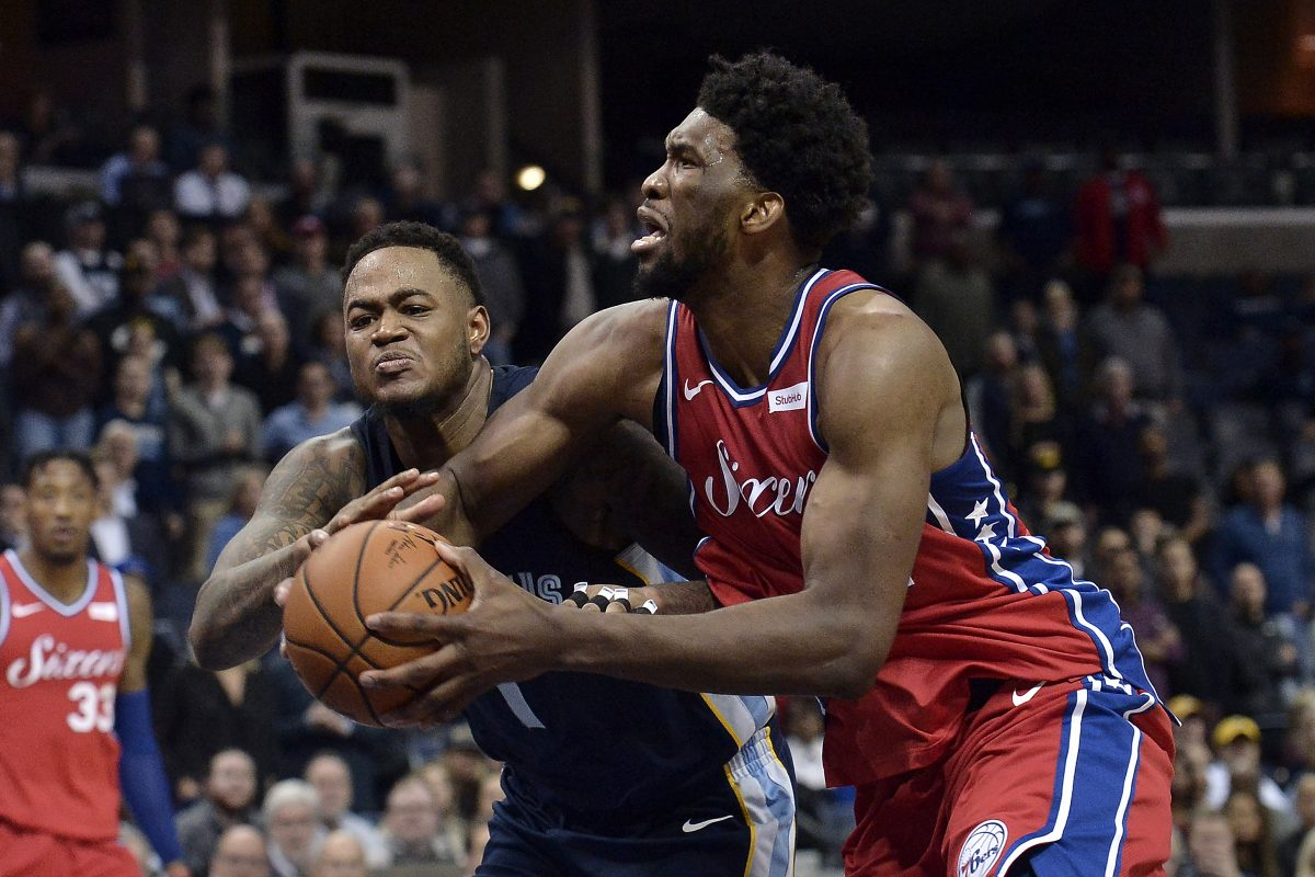 Joel Embiid drives against Memphis Grizzlies forward Jarell Martin in the second half. Embiid had a rough night.