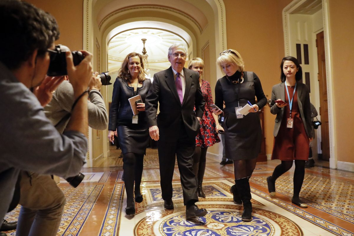 Senate Majority Leader Mitch McConnell of Ky., walks back to his office on Capitol Hill in Washington, Monday, Jan. 22, 2018.