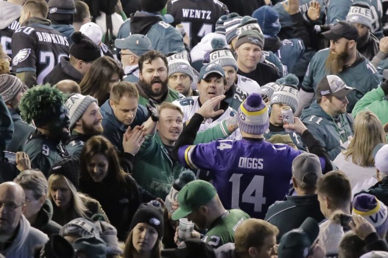 Eagles fans shout at Vikings fan at halftime during the NFC Championship game at Lincoln Financial Field on Sunday.