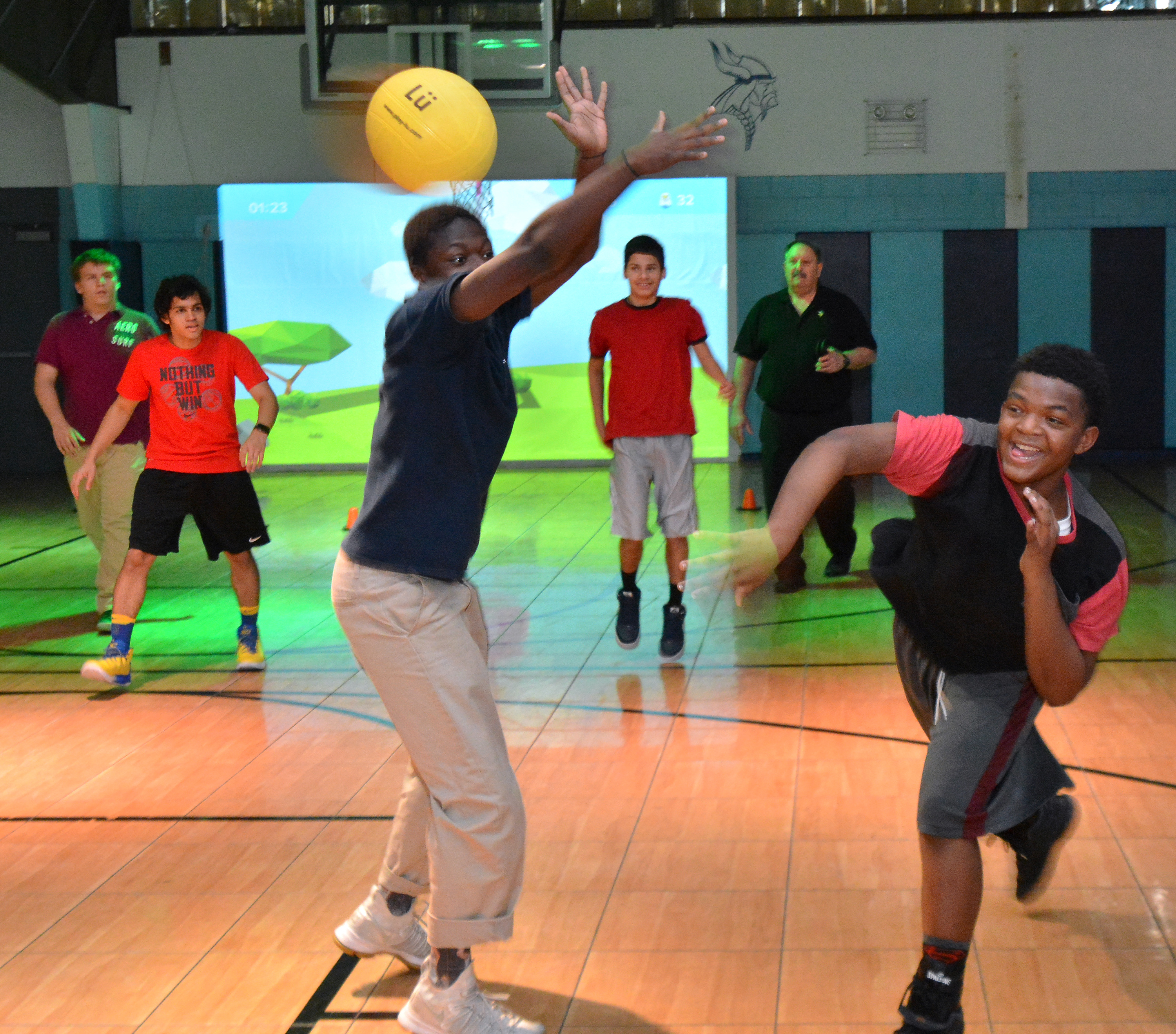 Valley Day School ninth grader Darnell Braxton,R, and fellow students take part in activities in the Lu Interactive Playground instructed by Physical Education teacher James Romano,back R, at the school in Morrisville Pa. on Friday January 19,2018. Mark C Psoras/For the Inquirer