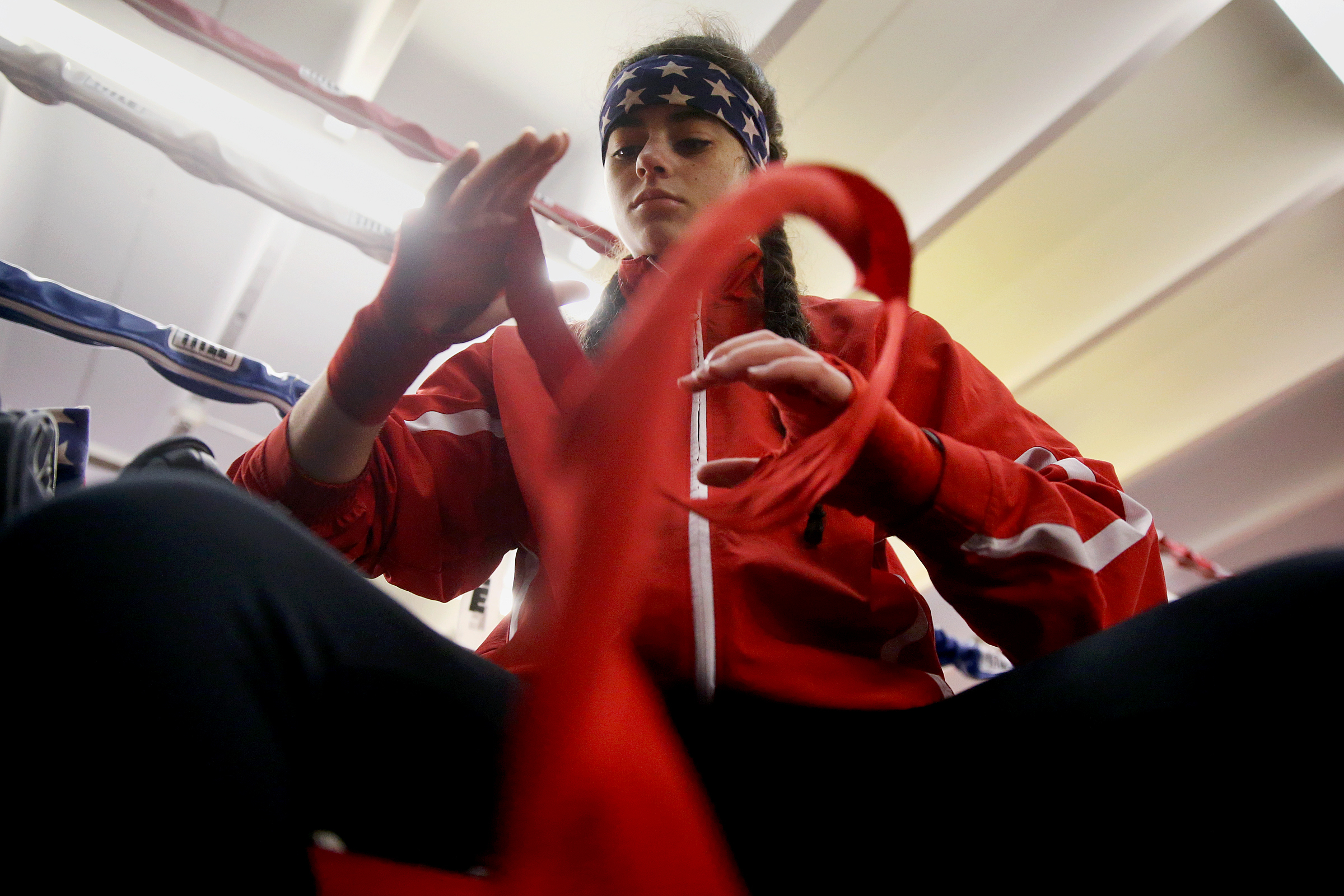 Natalie Dove, 16, wraps her hands before putting on gloves while training at Philly´s Next Champ boxing gym. TIM TAI / Staff Photographer