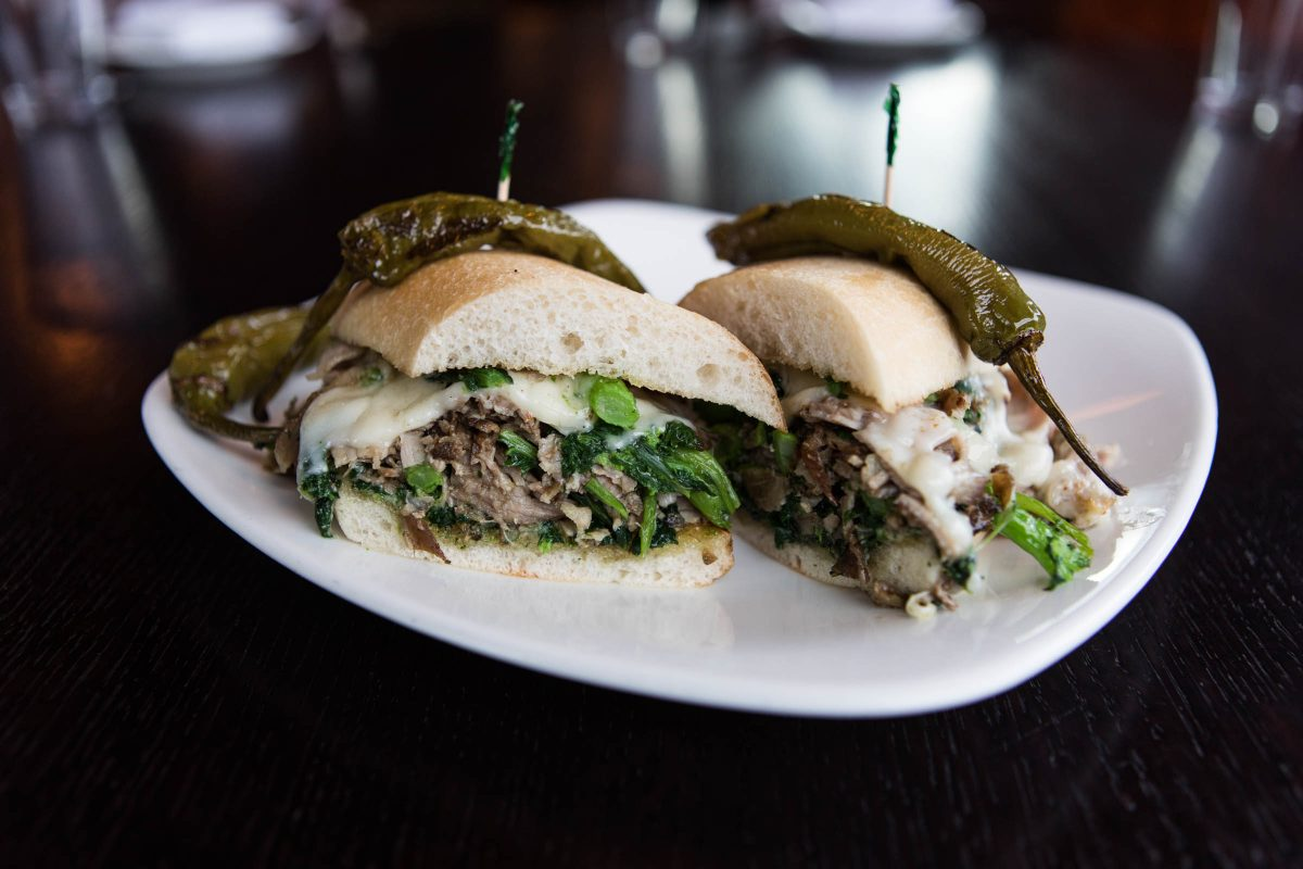 A Veteran's Stadium roast pork sandwich with braised greens and provolone from Farm and Fisherman restaurant in Horsham, Pa.