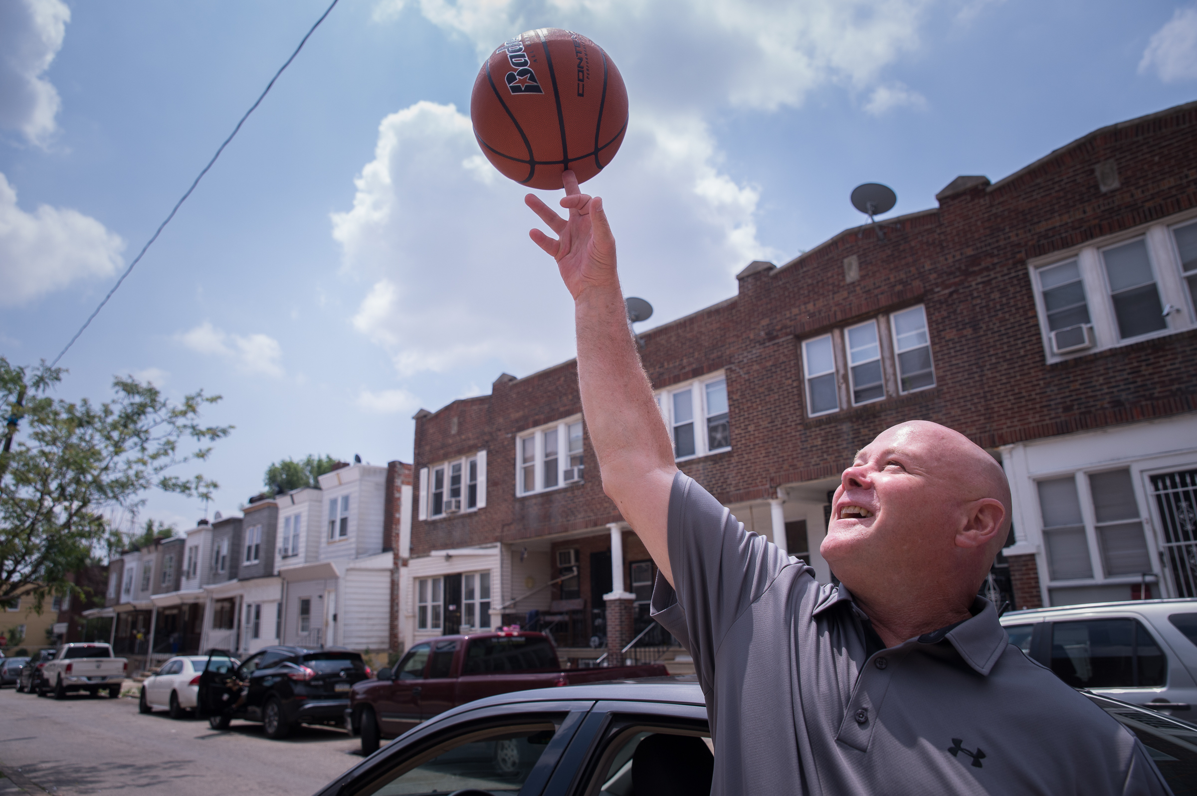 Mike Gibson, a process server who grew up in Southwest Philadelphia, spins a ball outside the John M. Patterson elementary school at 70th and Buist on June 14th, 2017.