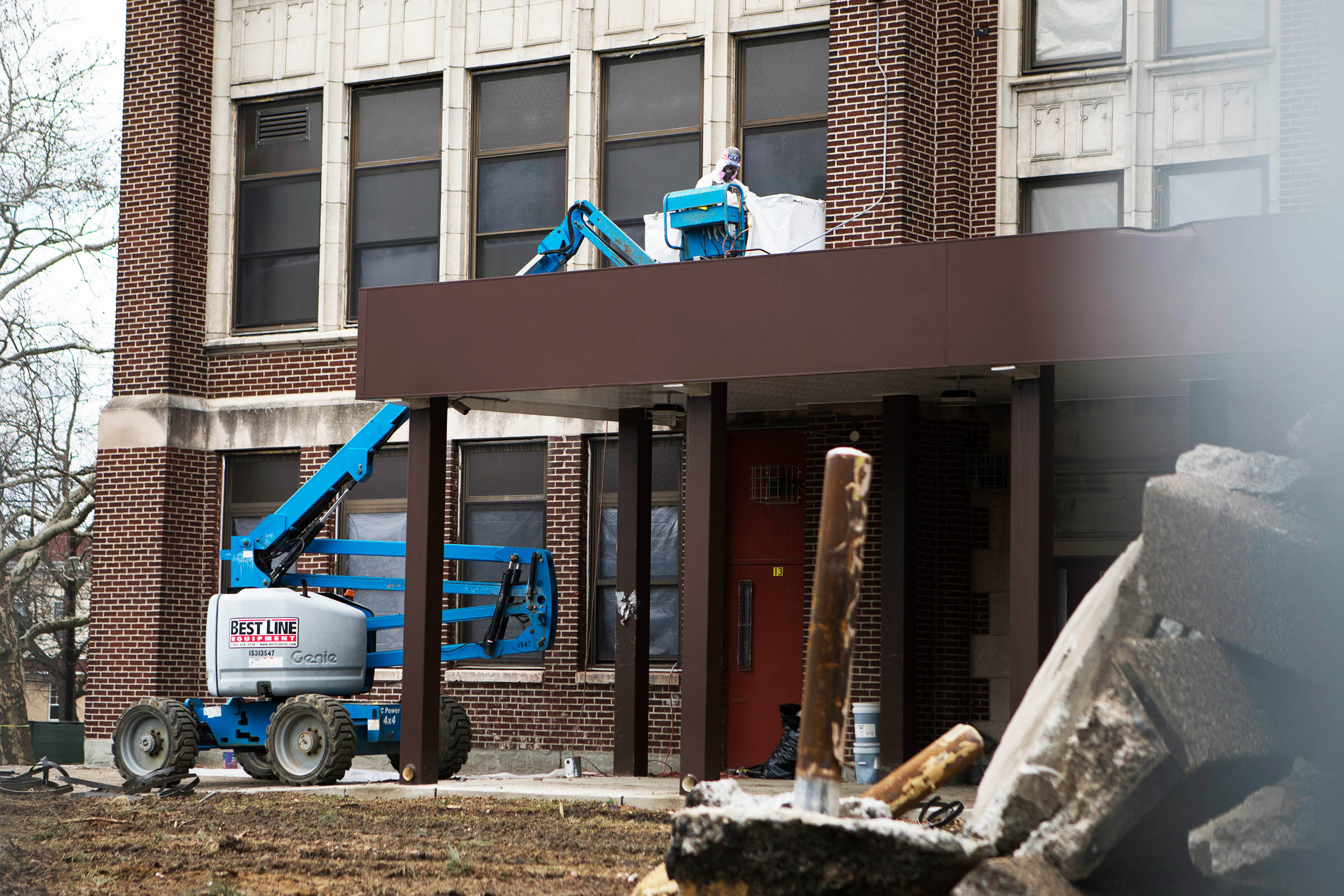 A worker uses a small crane as a rear annex to Camden High School is prepared for demolition. Some in the city hope to save the original, 1916 portion of the school.