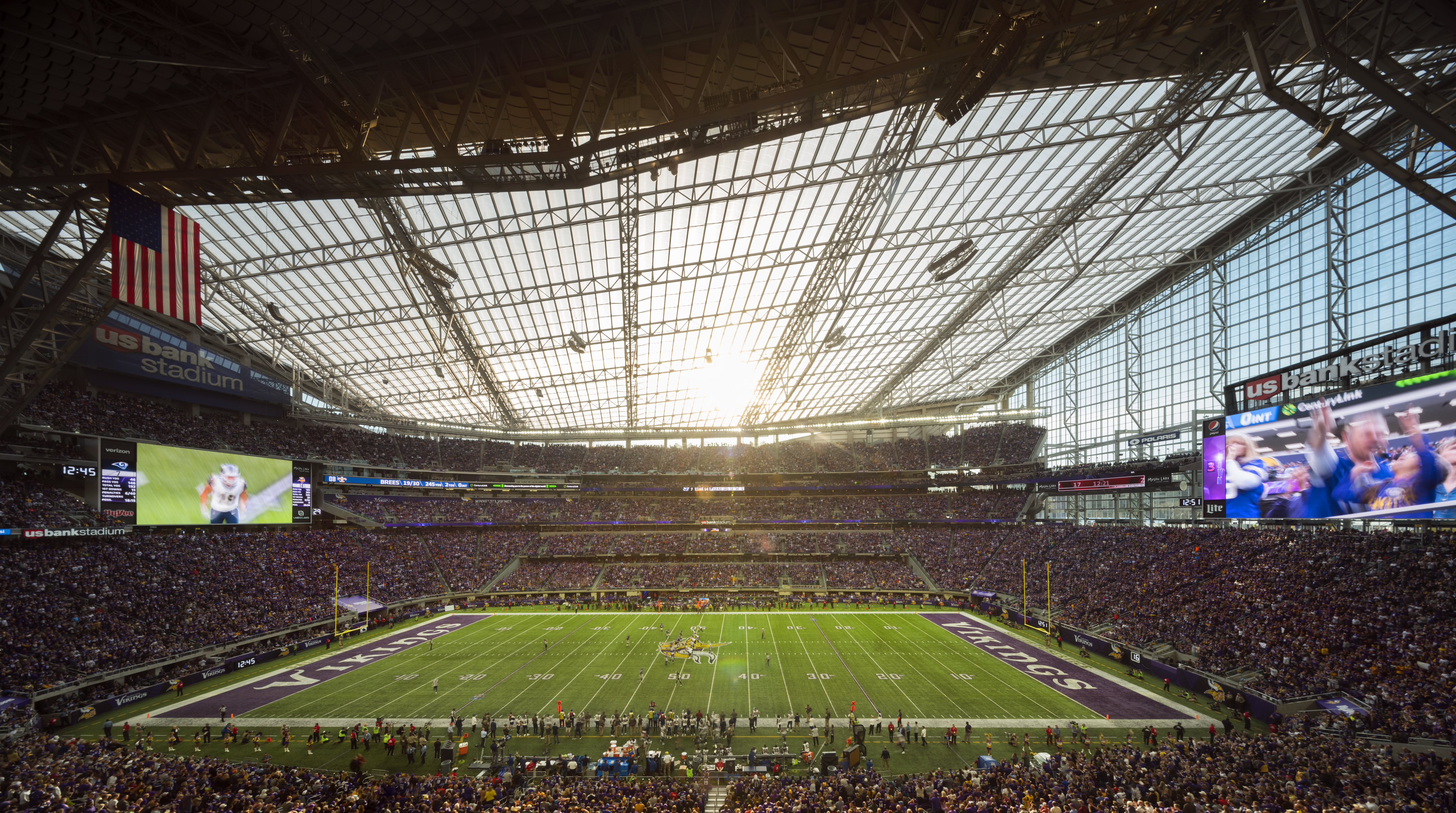 U.S. Bank Stadium in Minneapolis is one of a new generation of glassy, modernist, roofed football stadiums. Designed by HKS, it is linked to downtown and the airport by a light-rail system. The glass walls enable natural light into the venue and allow fans to see views of the skyline.