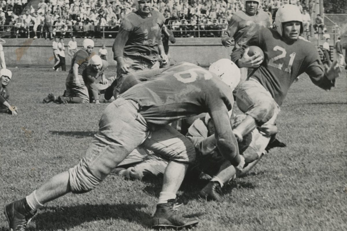 Davey O'Brien tackled during a rush, 1939.