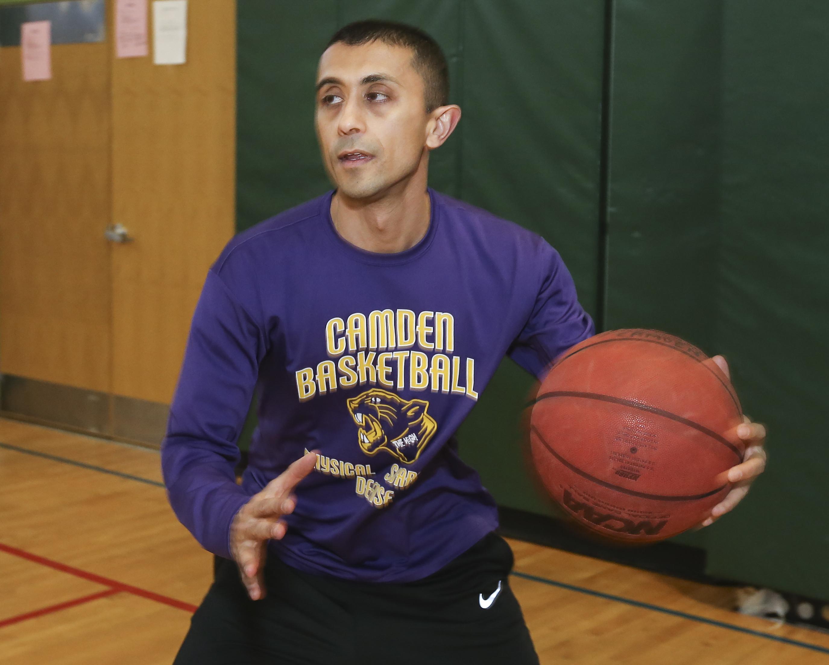 Camden School superintendent Paymon Rouhanfard is an assistant basketball coach at Camden Creative Arts High School. Rouhanfard at practice, Tuesday, January 30, 2018 . STEVEN M. FALK / Staff Photographer