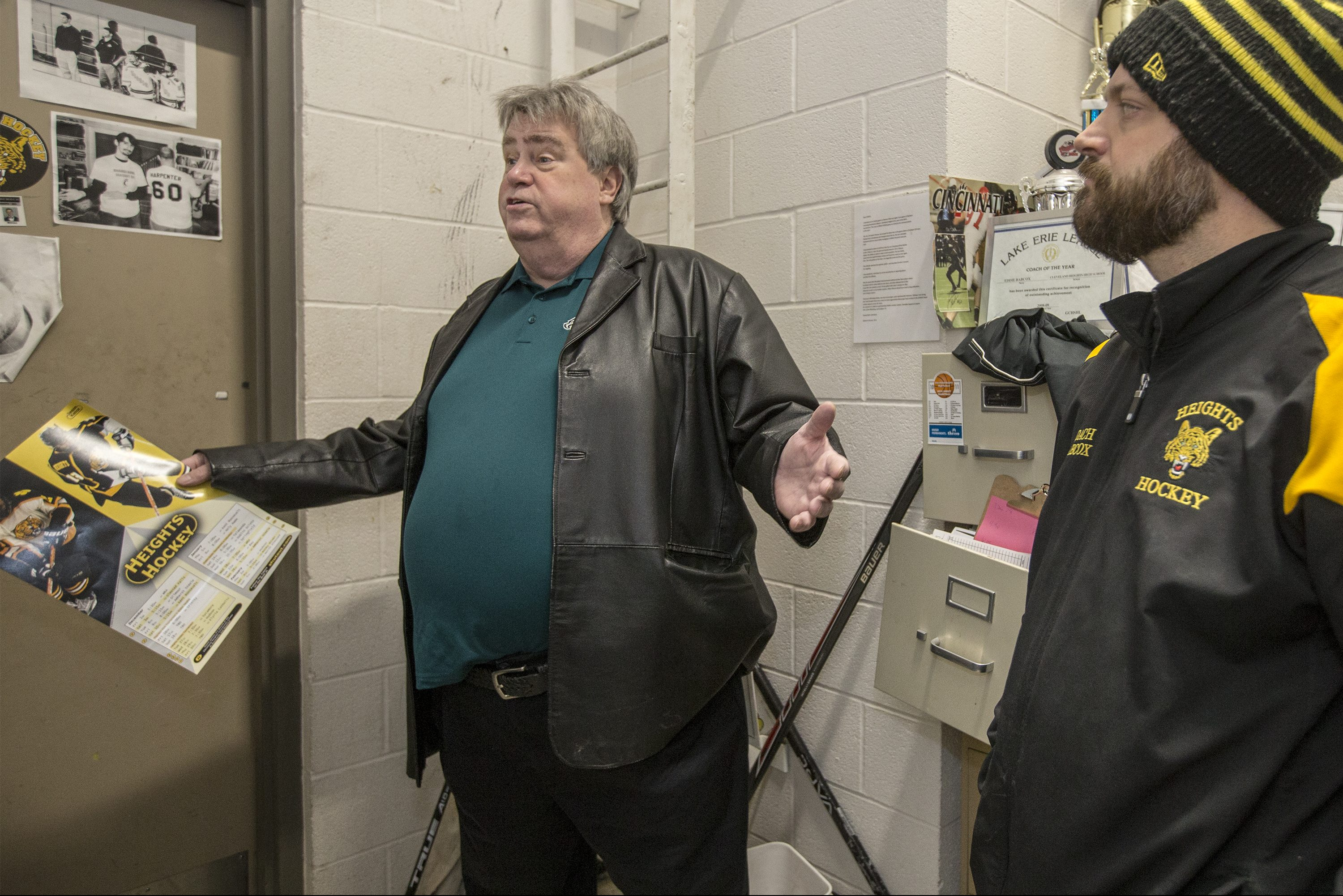 Ed Kelce, left, father of Eagles center, Jason Kelce, talks about his son´s hockey years with his hockey coach, Eddie Babcox, right, in Babcox´s office at the Cleveland Heights Community Center Ice Rink on Tuesday.