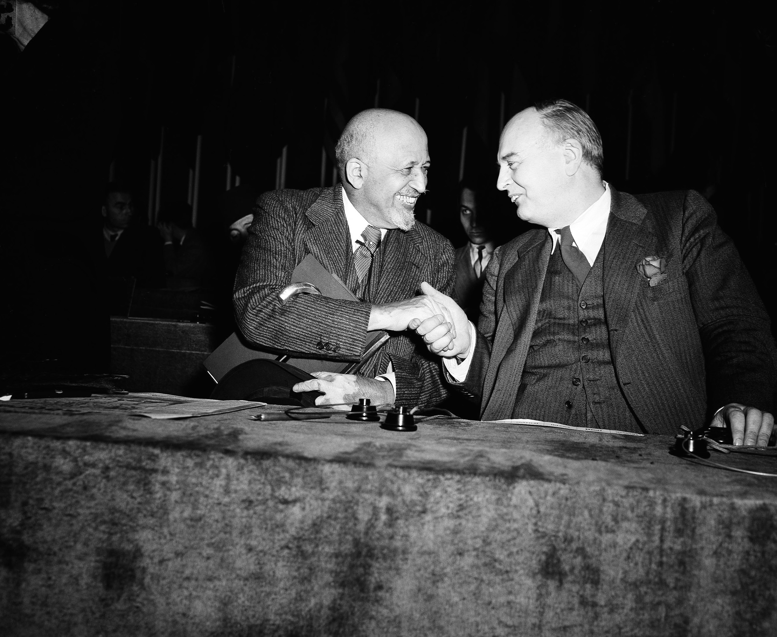 British Labour Party politician Konni Zilliacus, right, greeted W.E.B. DuBois at the World Peace Conference at the Salle Pleyel in Paris on April 21, 1949. (Jean Jacques Levy/AP)