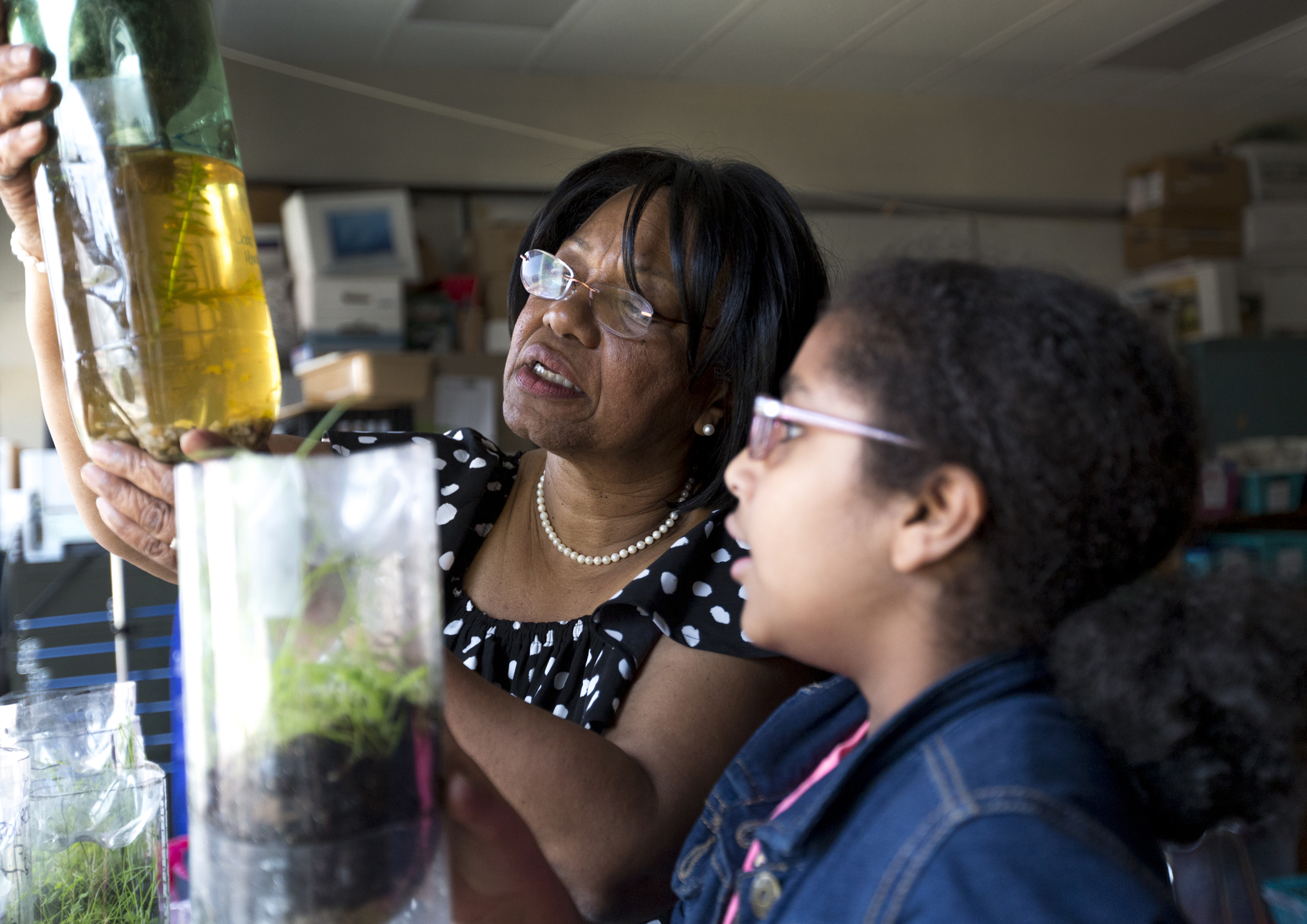 Teacher Carolyn Gray uses ecocolumns with fifth-grader, Nejat Moges, at