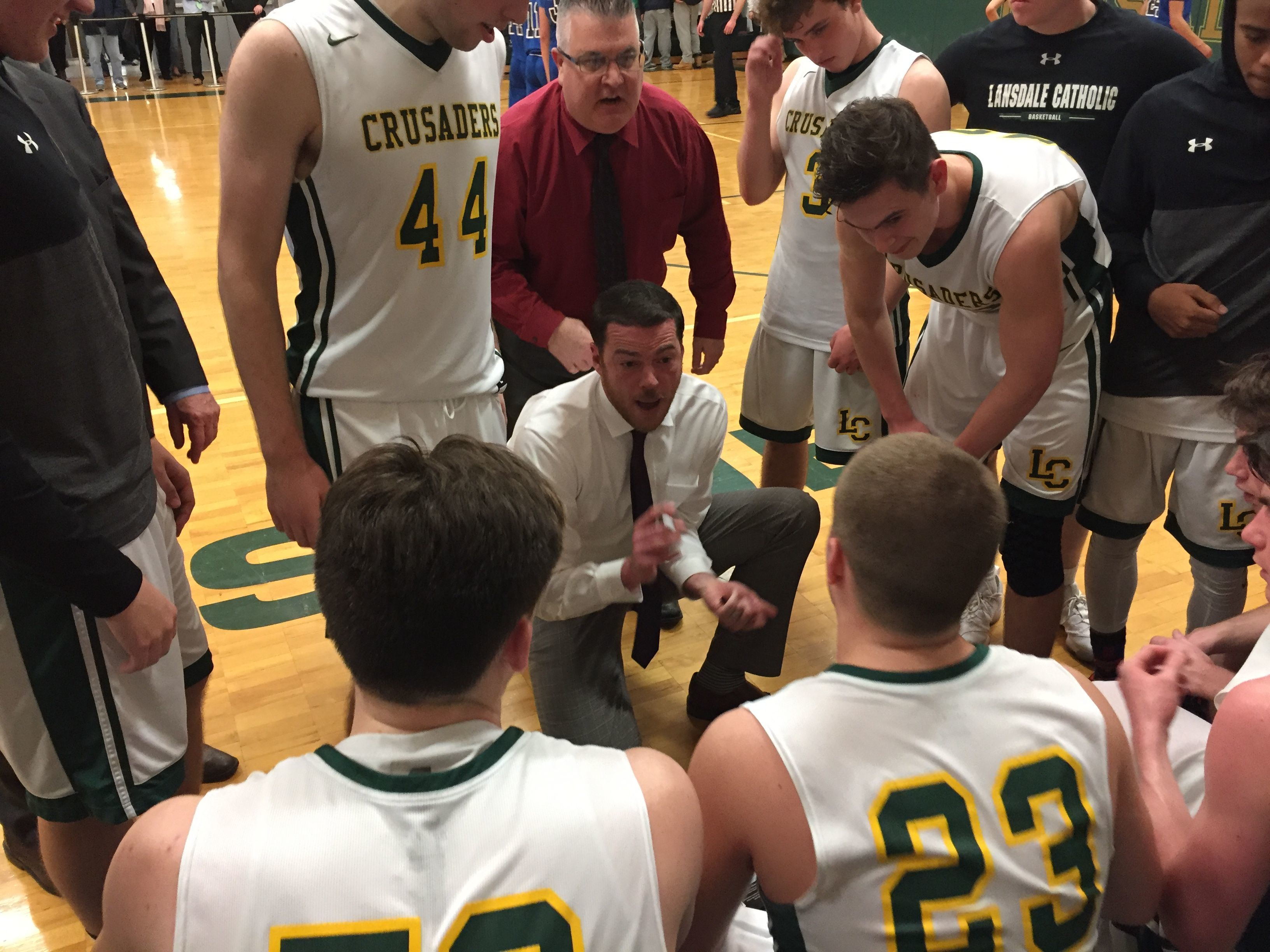 Lansdale Catholic coach Joe Corbett instructs his squad in Monday nights win over Conwell-Egan.