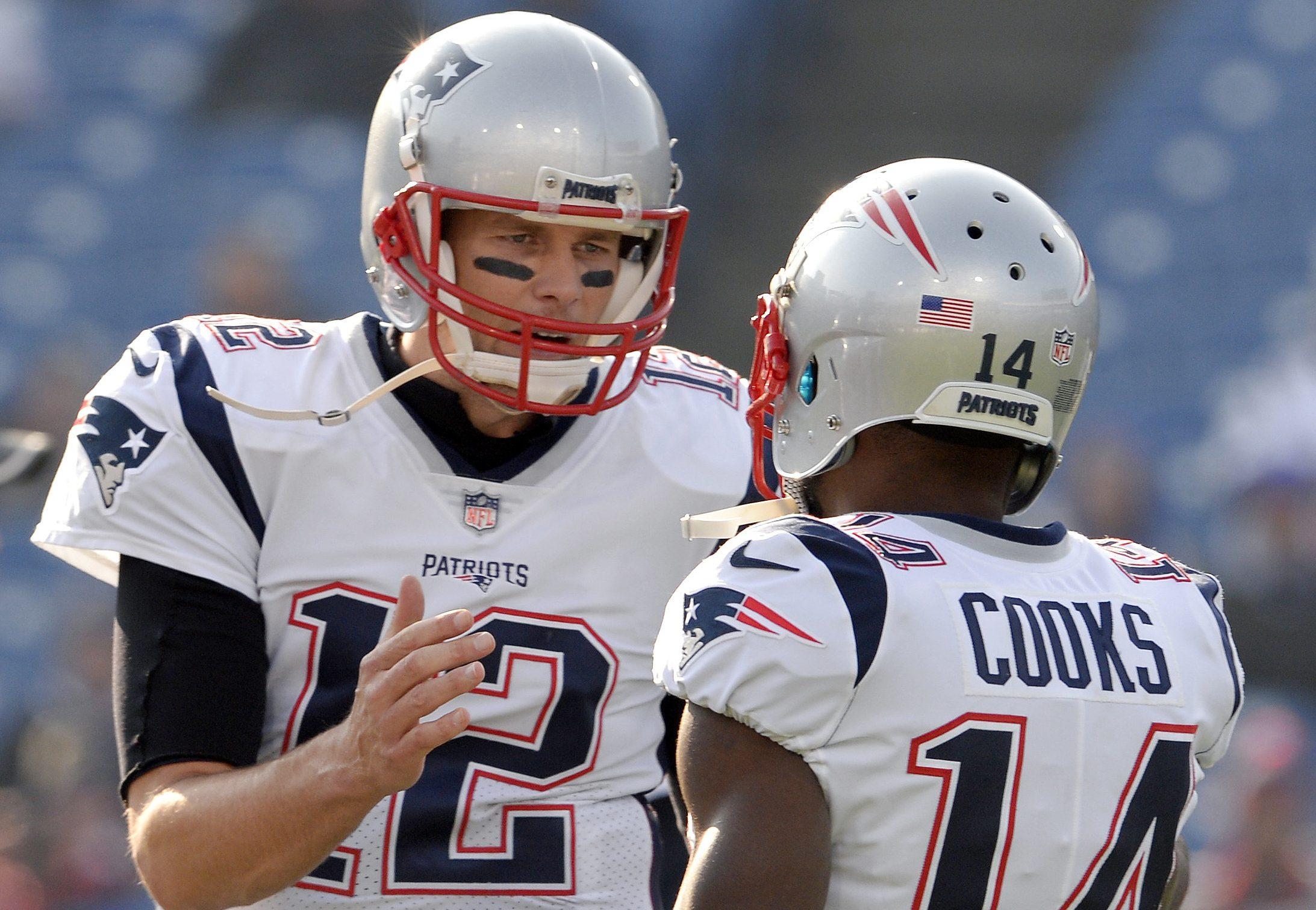 Tom Brady talks with Brandin Cooks.