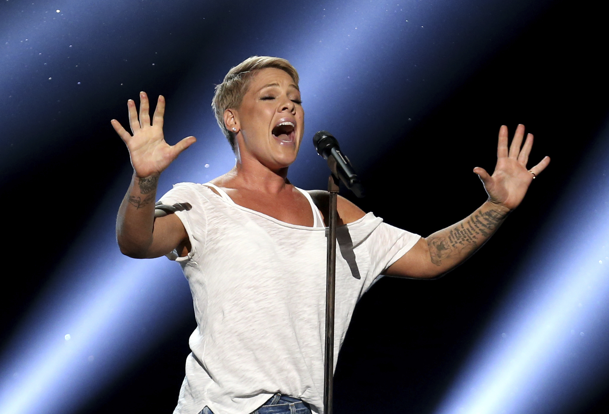 """FILE - In this Jan. 28, 2018, file photo, Pink performs """"Wild Hearts Can´t Be Broken"""" at the 60th annual Grammy Awards at Madison Square Garden in New York. Pink will sing the National Anthem before Super Bowl 52 on Sunday, Feb. 4, and will perform a concert Friday night at NOMADIC LIVE! at The Armory. (Photo by Matt Sayles/Invision/AP, File)"""