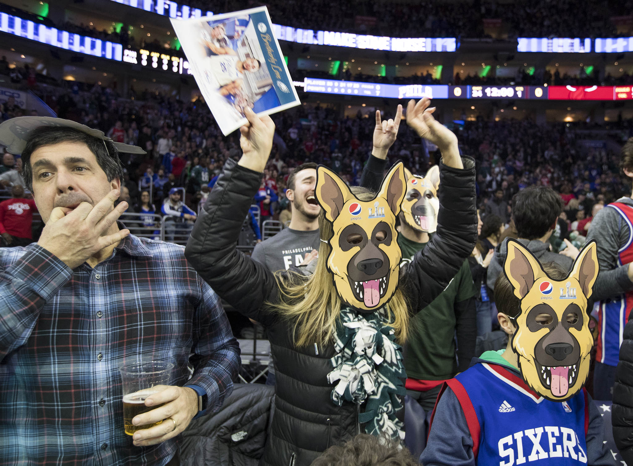 Sixers´ point guard Ben Simmons sports a dog mask in support of the Eagles. Simmons finished with 20 points, 6 rebounds, and 5 assists in the team´s win.
