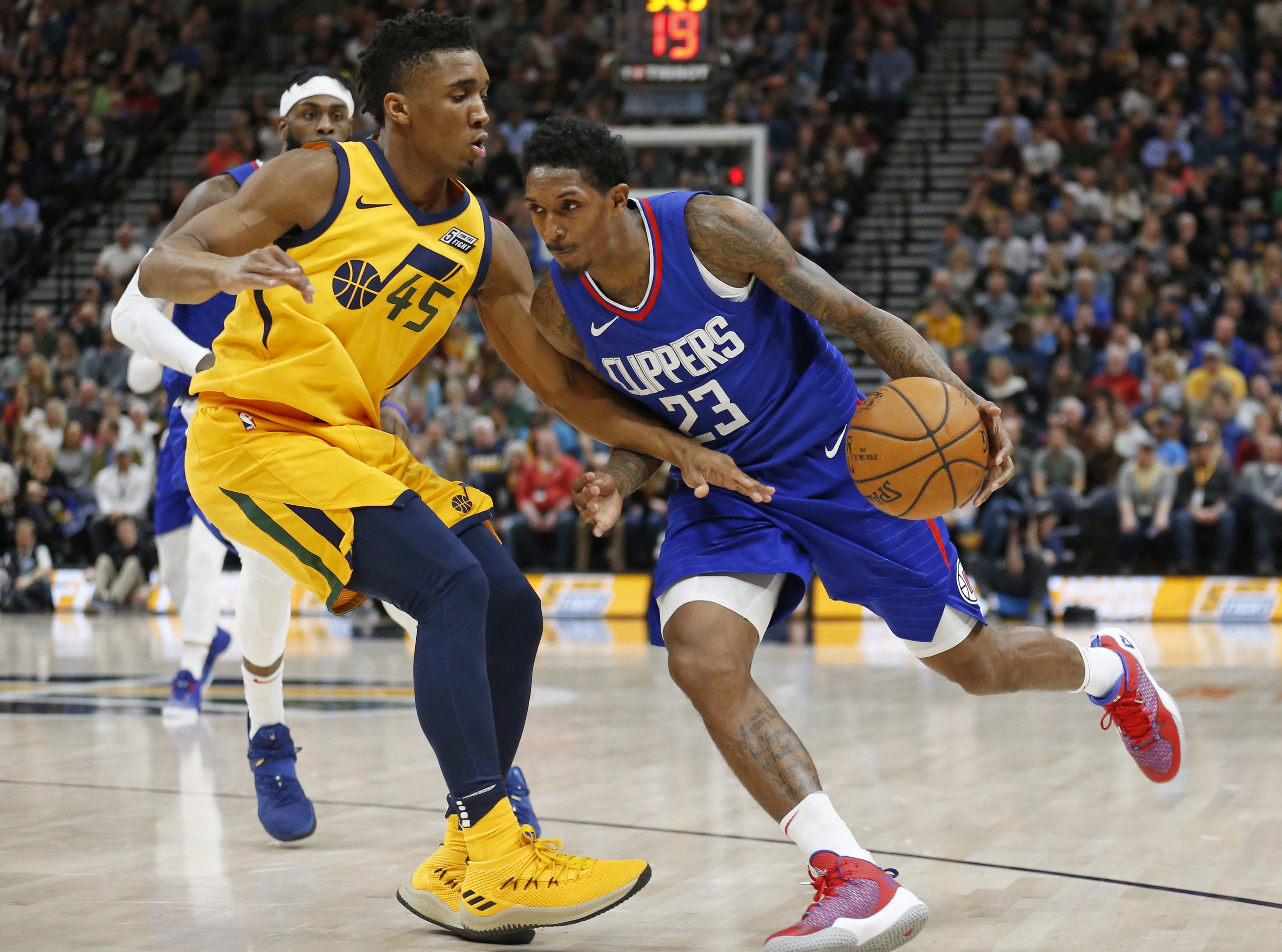 Utah Jazz guard Donovan Mitchell (45) guards Los Angeles Clippers guard Lou Williams (23) in the first half during an NBA basketball game Saturday, Jan. 20, 2018, in Salt Lake City.
