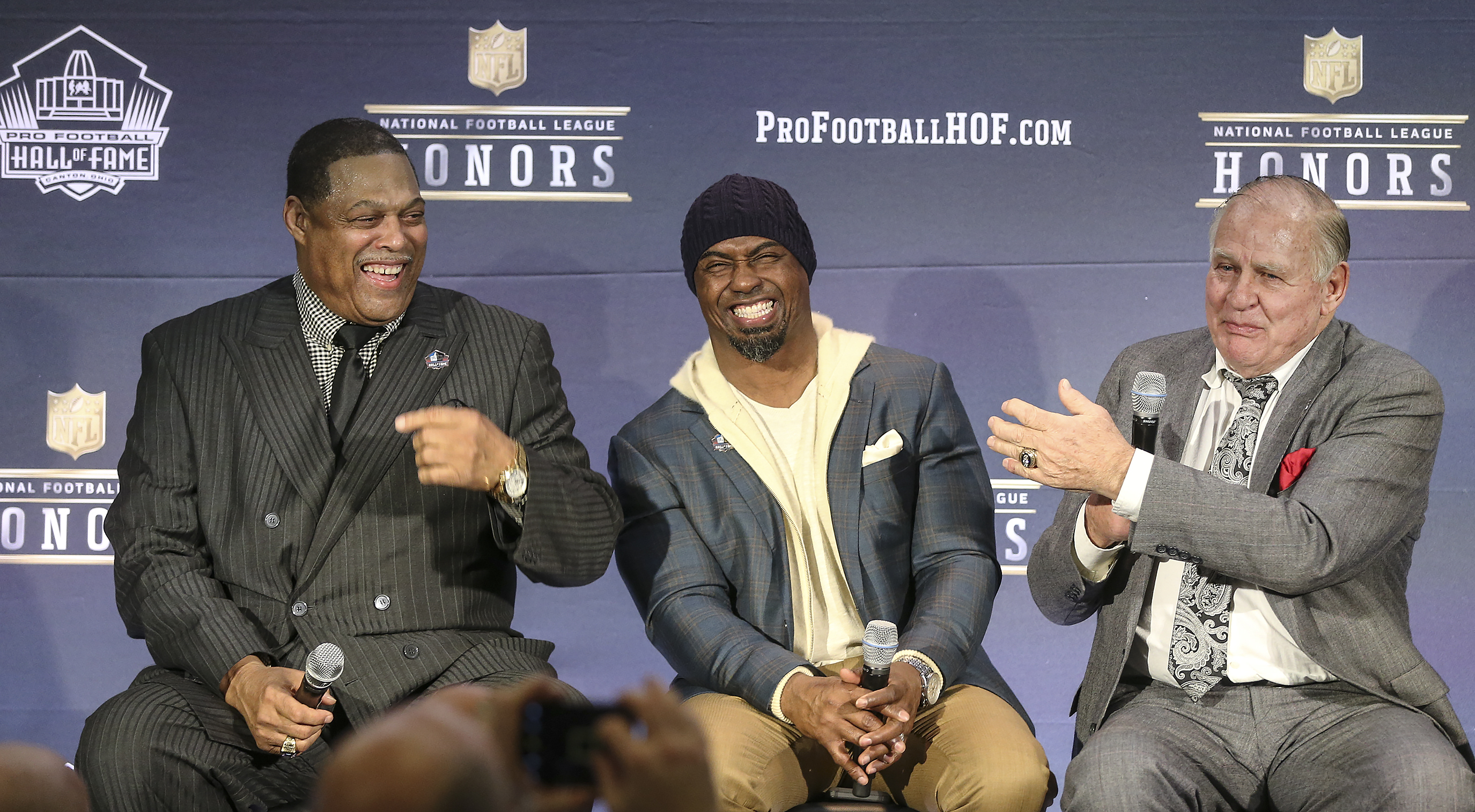 Brian Dawkins, center laughs at a story told by Jerry Kramer, right and Robert Brazile, left after they were elected to the 2018 NFL Hall of Fame at the University of Minnesota in Minneapolis, Saturday, February 3, 2018.
