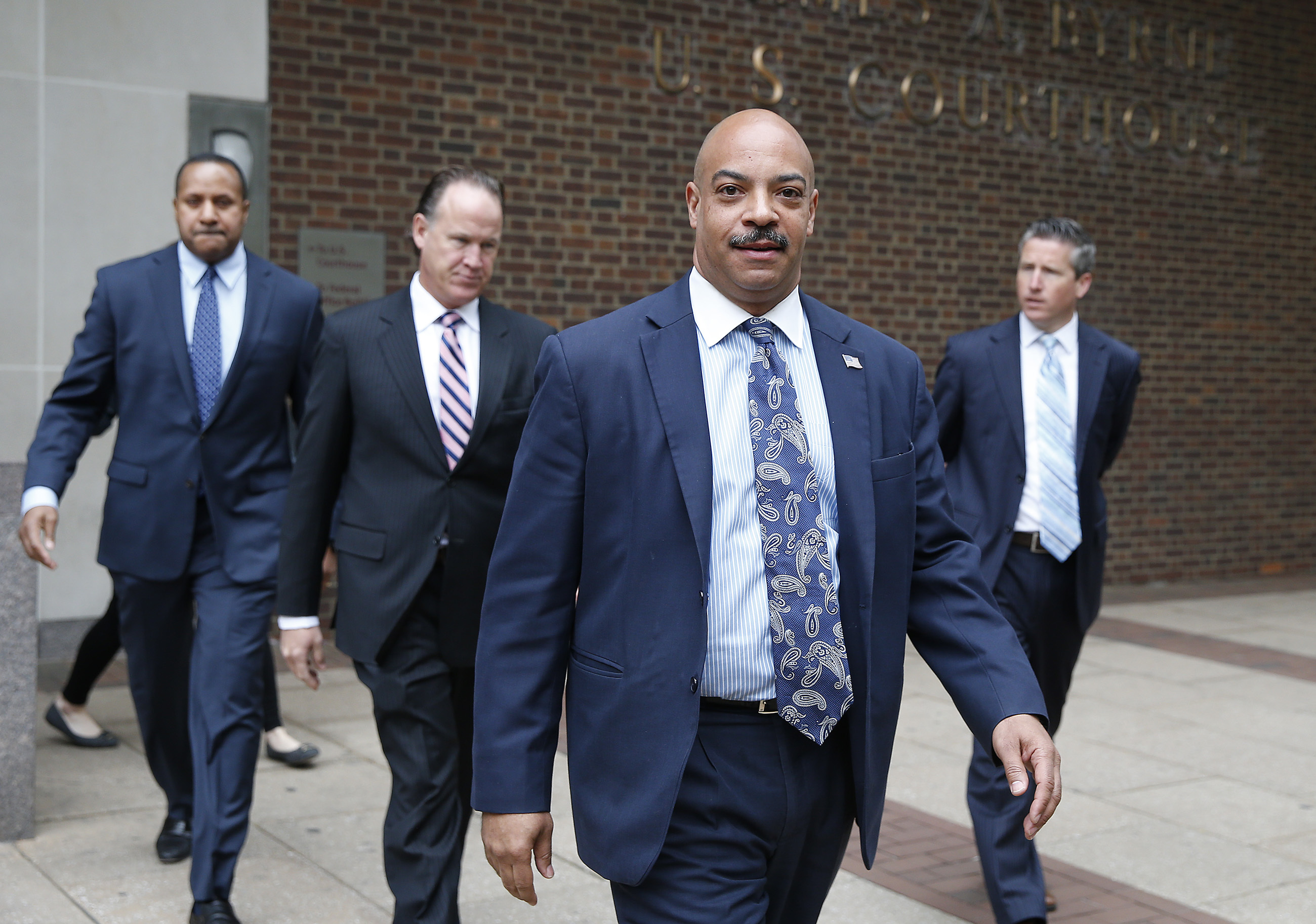 Seth Williams, center, leaves after being arraigned on additional charges at federal court in Philadelphia, PA on May 11, 2017. (DAVID MAIALETTI / Staff Photographer)