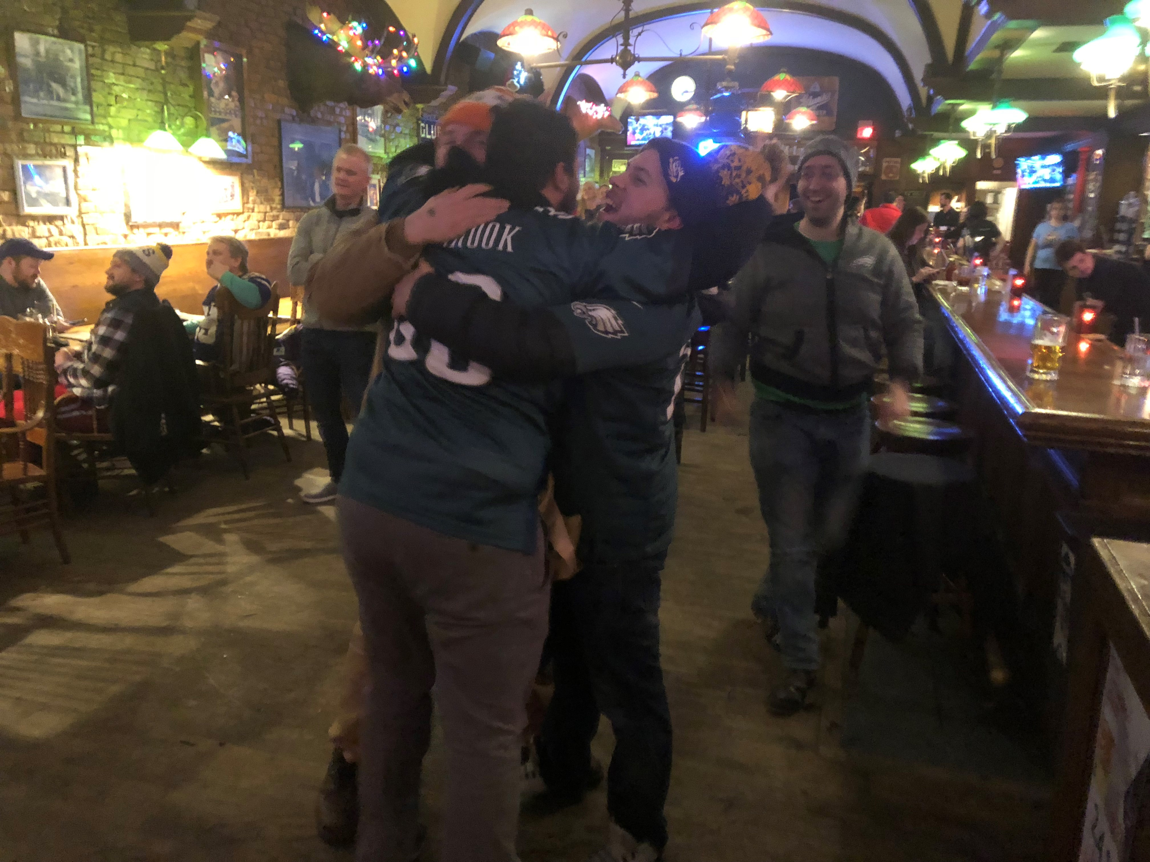 Joy in Minneapolis! At a bar blocks from the stadium, Eagles fan Chris Jordan (right), celebrates a Super Bowl victory.