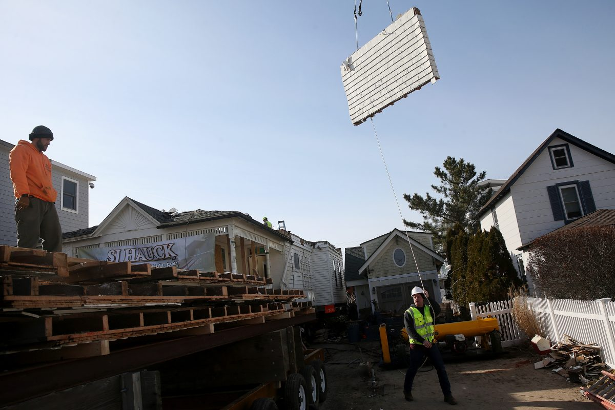 Steve Hauck, right, owner of SJ Hauck House Movers, guides a wall section from a house in Avalon, N.J., onto a flatbed truck for transport on Friday, Feb. 9, 2018. The Victorian-style house was slated to be torn down for redevelopment, but is instead being taken apart to be moved to Egg Harbor Township. TIM TAI / Staff Photographer