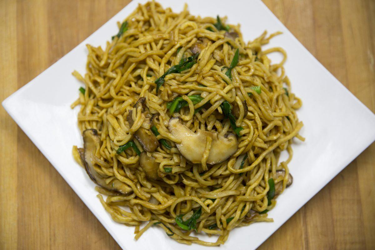 Long life noodles, a traditional Chinese New Year food, at Nom Wah Tea Parlor.