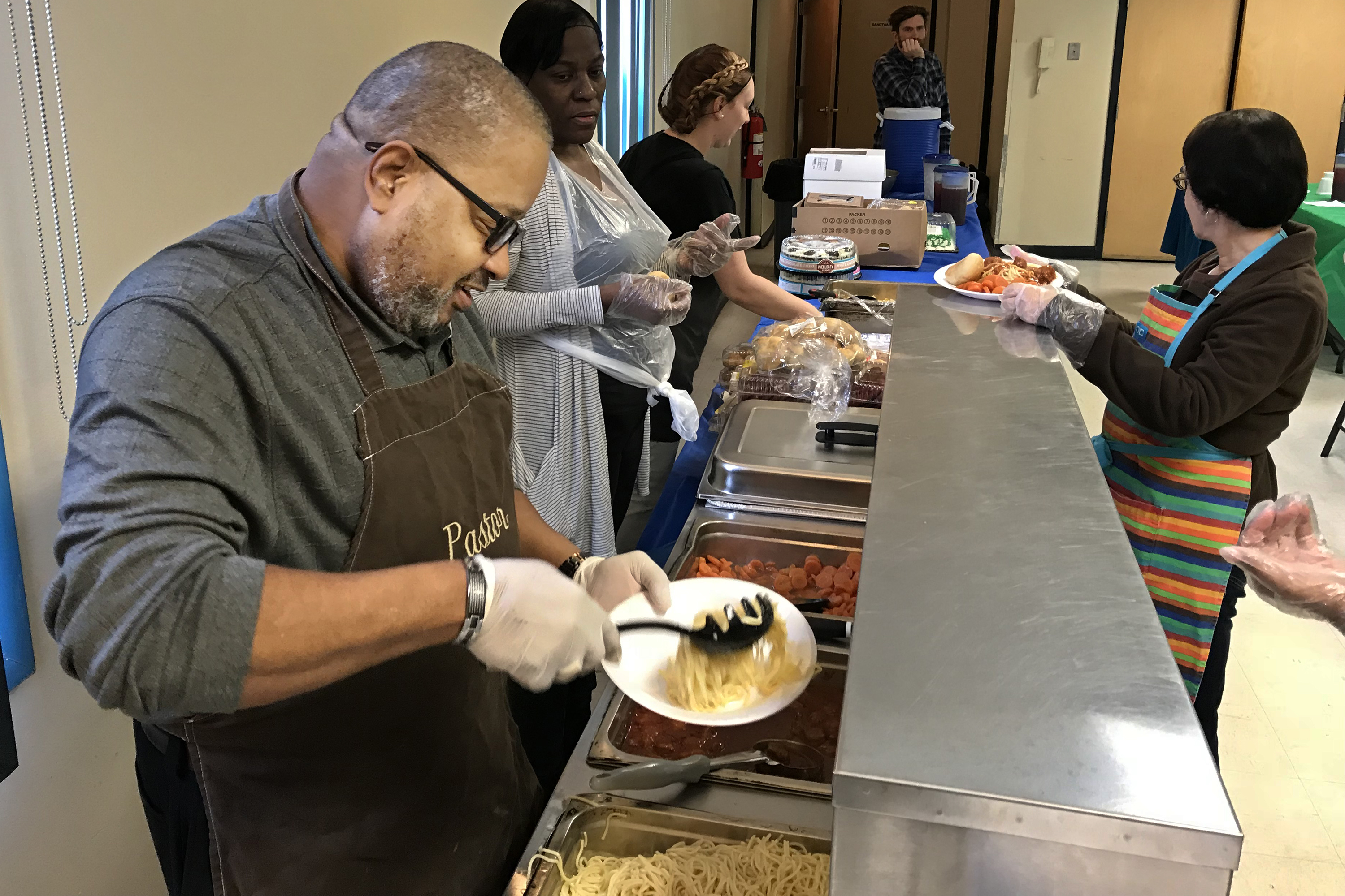Bethel A.M.E. pastor Charles E. Wilkins, Sr. fills a plate with pasta, on February 6, 2018, as he works the food line at the church's soup kitchen, that serves hot meals four times a week, restaurant style to the needy in Millville, NJ. MICHAEL BRYANT / Staff Photographer
