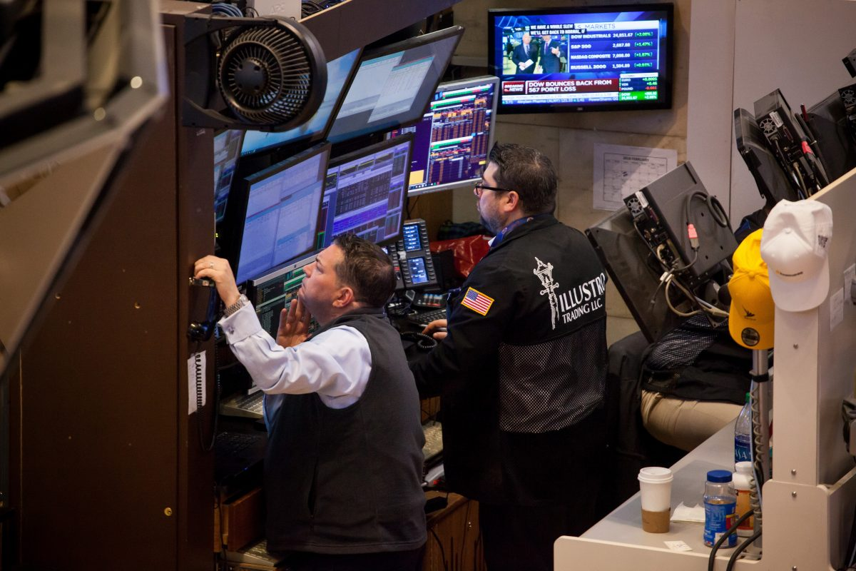 Traders work on the floor of the New York Stock Exchange (NYSE) in New York on Tuesday.