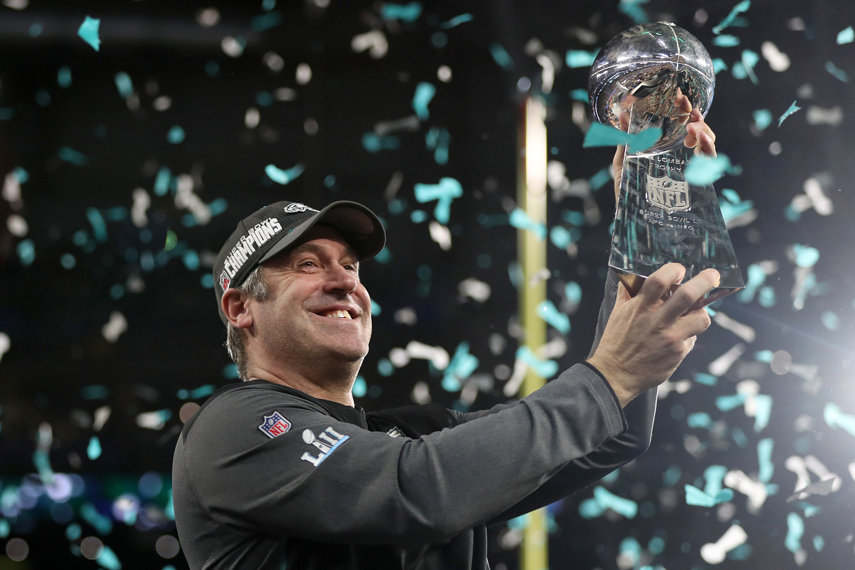 Philadelphia Eagles head coach Doug Pederson hoists up the Lombardi trophy during the ceremony after Super Bowl LII on Sunday.