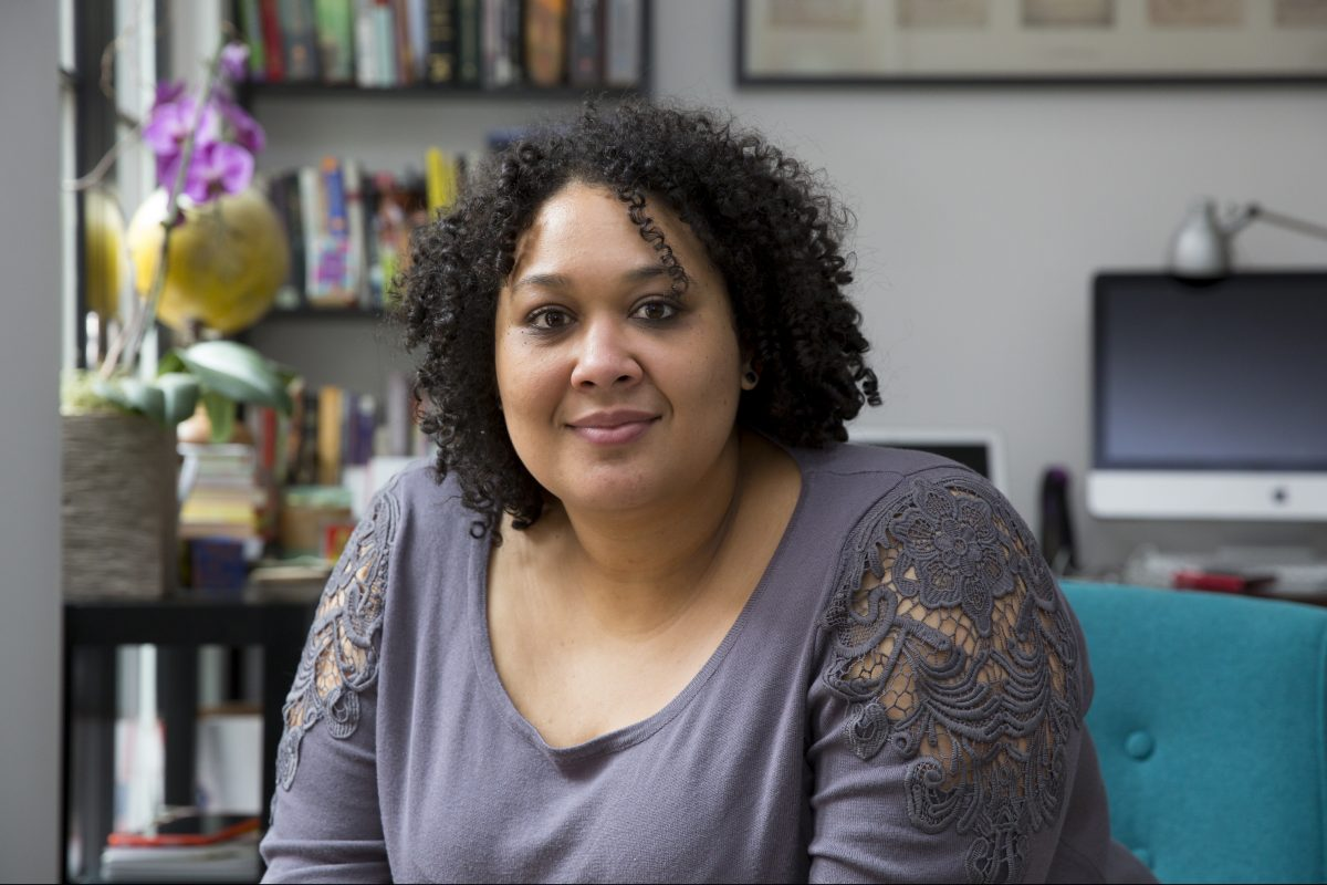 "Writer and activist Crystal Cheatham, shown here in her home office in Philadelphia. Cheatham is the developer of ""Our Bible,"" a new app aimed at LGBTQ people of faith and progressive Christians."