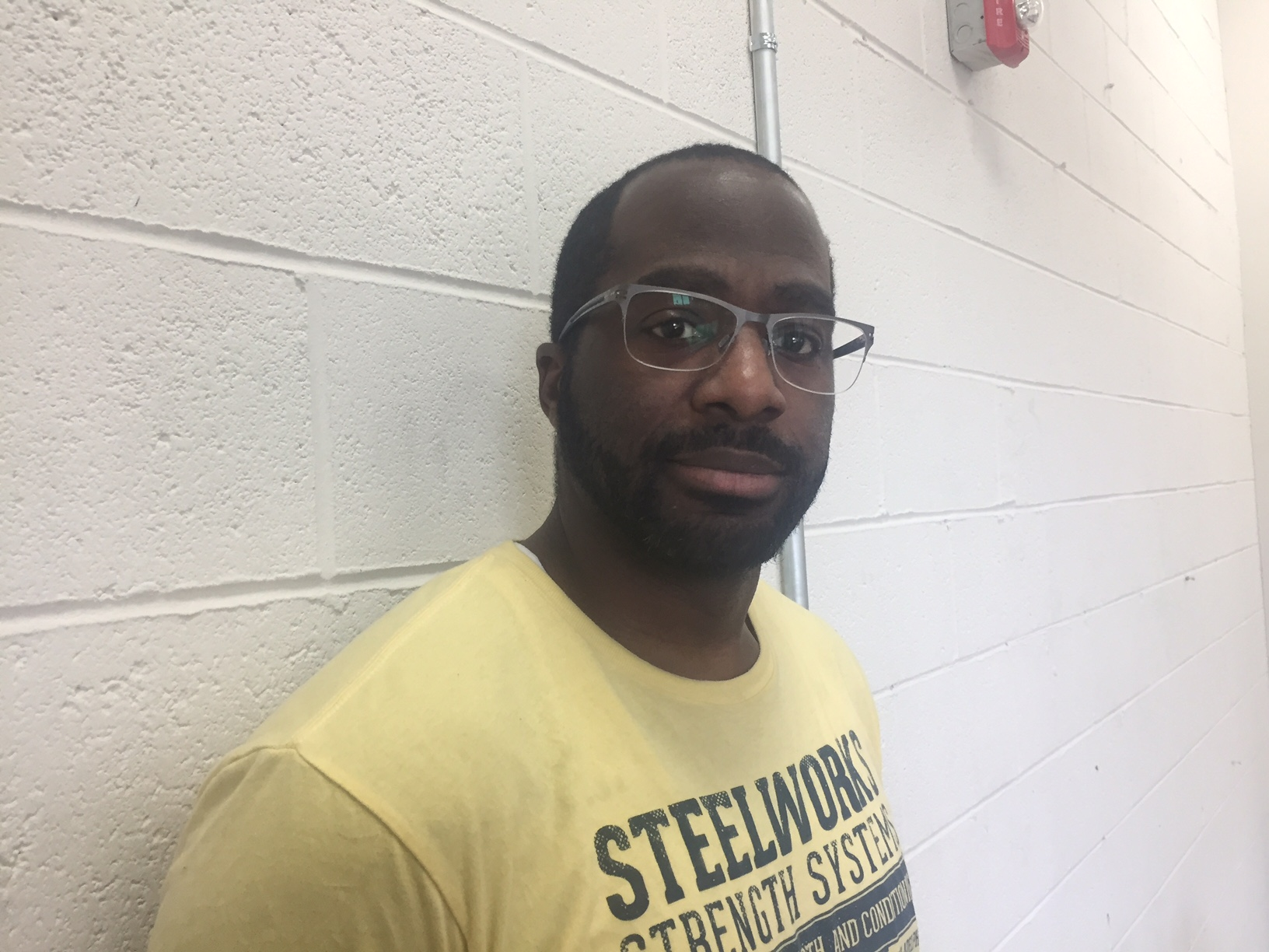 Kobie Xavier, a trainer at Steelworks Strength Systems, witnessed a recent brawl outside of the gym.