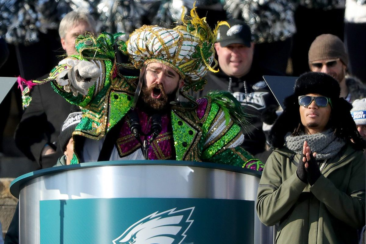 Dressed in Mummers attire, Eagles center Jason Kelce pauses during his colorful speech on the Art Museum steps.
