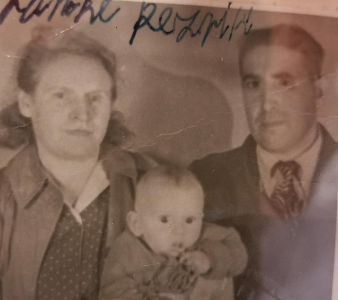 Sara and Jacob Resnick, with their son Carl, photographed at their arrival at Ellis Island after World War II.