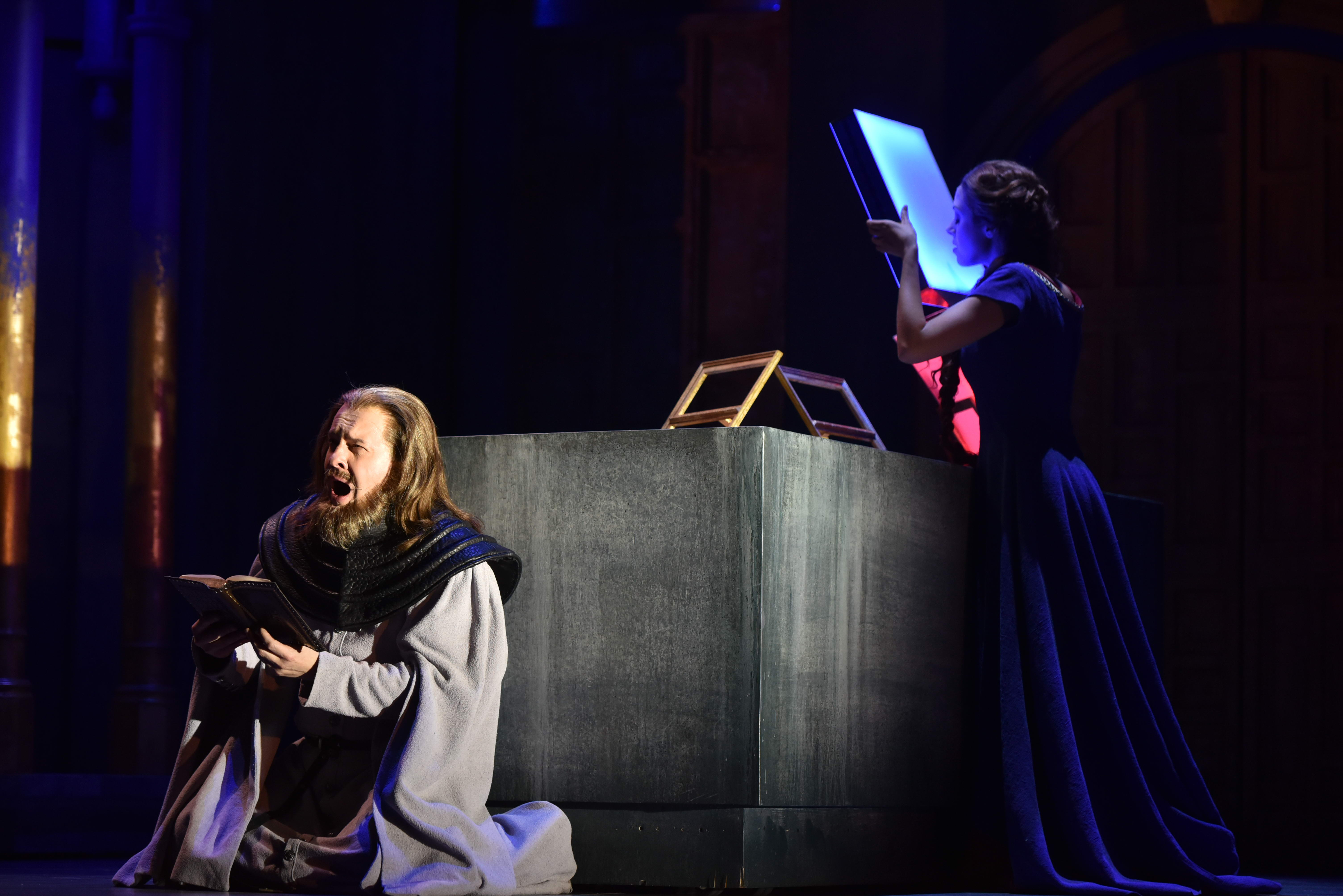 The Protector (baritone Mark Stone) and Agnès(soprano Lauren Snouffer), who, as a woman, has not been taught to read. (KELLY & MASSA for OPERA PHILADELPHIA)