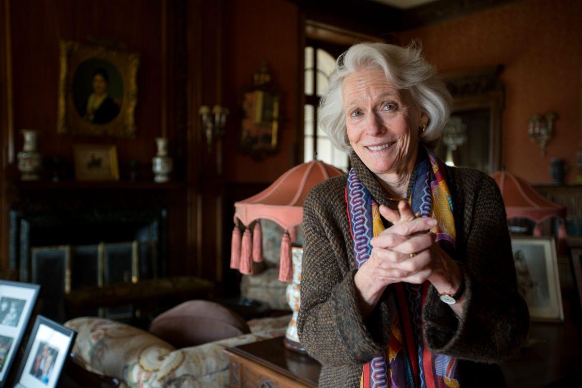 Joan Mackie smiles when recalling family stories in her late grandparents' estate, Ardrossan, in Villanova.