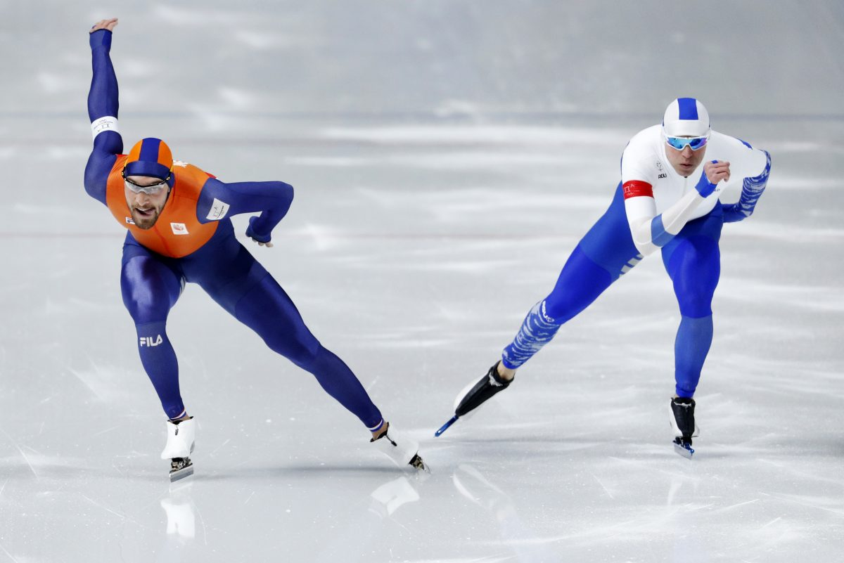 Gold medalist Kjeld Nuis of The Netherlands crosses over to the inside lane where Mika Poutala of Finland holds back and makes way to let Nuis through and make sure he does not ruin his gold medal race during the men´s 1,000 meters speedskating race at the Gangneung Oval at the 2018 Winter Olympics in Gangneung, South Korea on Friday.