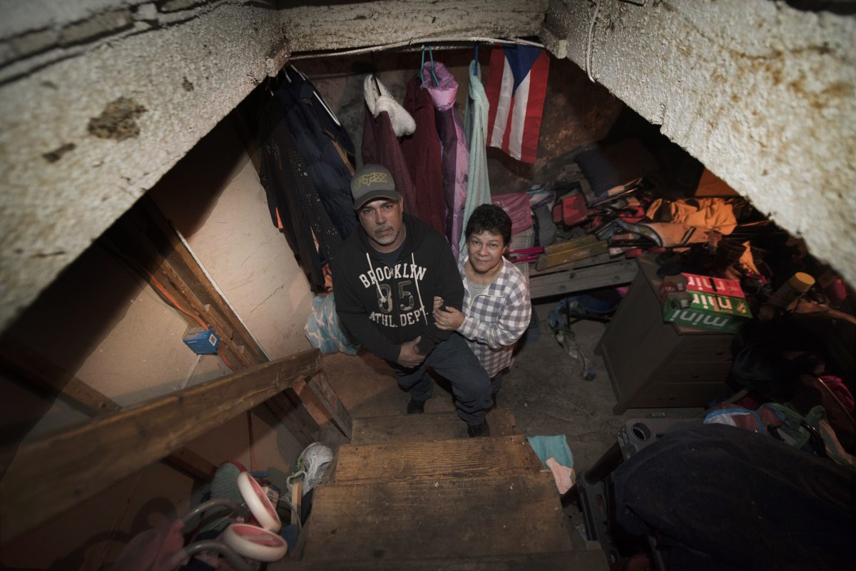 Jurabe Arroyo with his wife, Irma Cabrera are photographed in the basement of a home in North Philadelphia. Wednesday, Feb. 07, 2018. Juarbe Arroyo and his family lost everything in Hurricane Maria– their house, car and most belongings. They moved to Philadelphia where a relative offered her basement as temporary housing. They've been living in this basement for three months now and struggling to get a place of their own without any FEMA assistance.JOSE F. MORENO / Staff Photographer