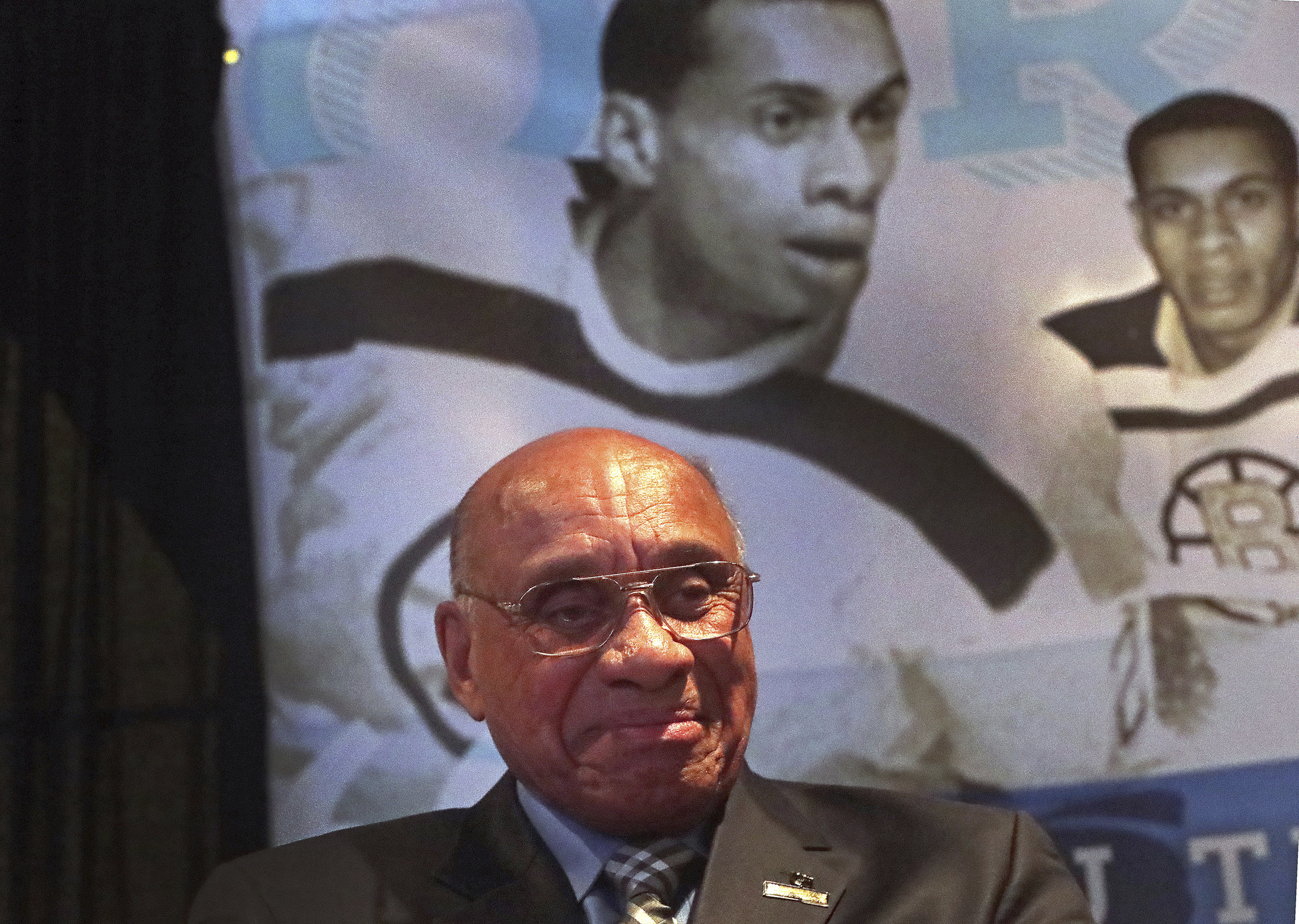 National Hockey League Diversity Ambassador Willie O´Ree, the first black player in the NHL, was honored during a ceremony in Boston on Wednesday, Jan. 17, 2018. The ceremony was attended by Boston Mayor Marty Walsh, NHL commissioner Gary Bettman and Boston Bruins Chief Executive Officer Charlie Jacobs, who joined together at TD Garden to announce that the Boston Parks and Recreation Department´s street hockey rink at Smith Field in Allston-Brighton is named in honor of O´Ree. (Barry Chin/The Boston Globe via AP)