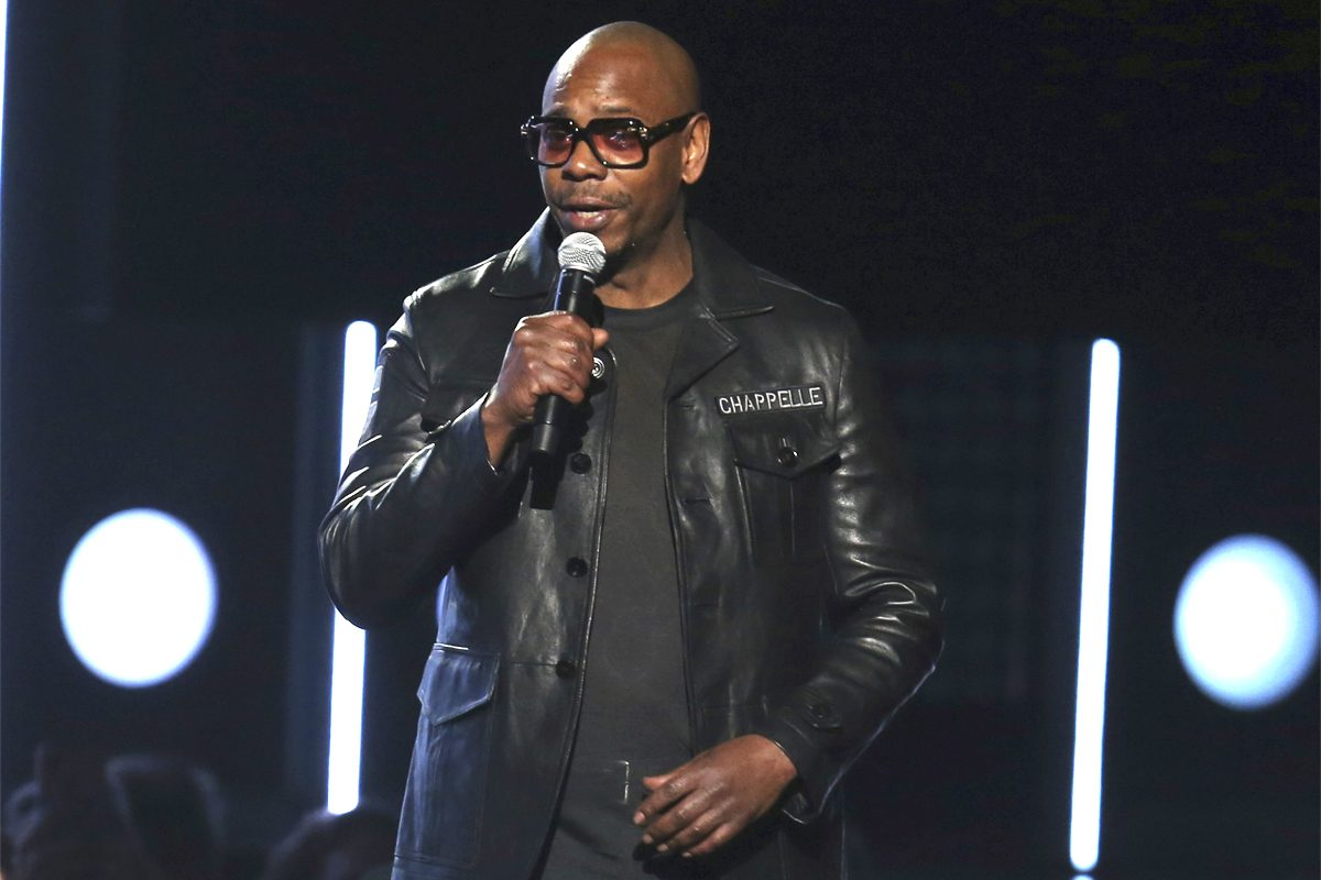 Dave Chappelle speaks at the 60th annual Grammy Awards at Madison Square Garden on Sunday, Jan. 28, 2018, in New York. Chappelle will host a Roots Jam session at this year's Roots Picnic at the Festival Pier at Penn's Landing in June.