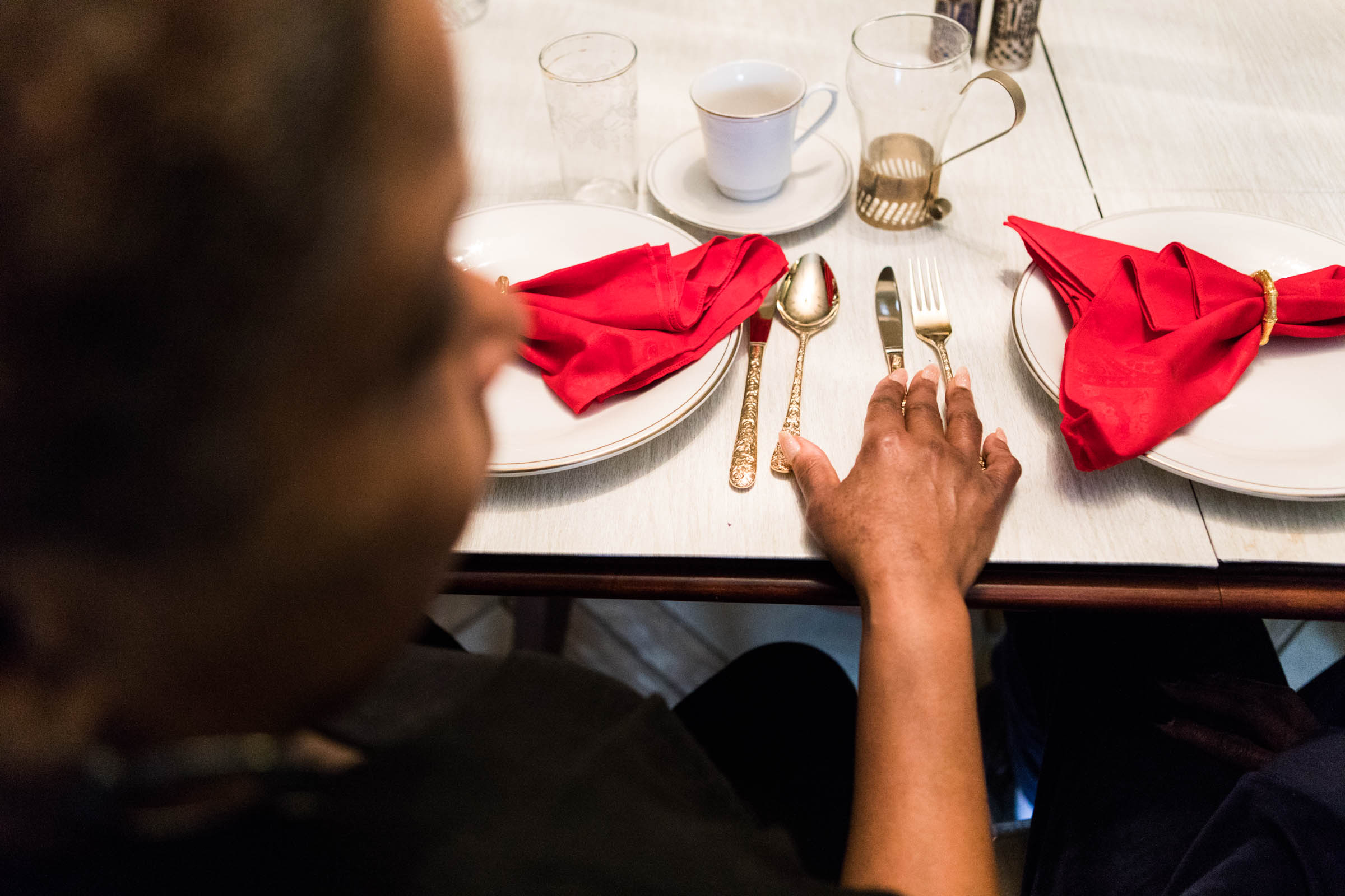 Cheryl Lee-Owens lays her hand on the dining room table of her mother´s Laverock, Pa. home on Friday, February 16, 2018. The fine china, glassware and silverware are family heirlooms.
