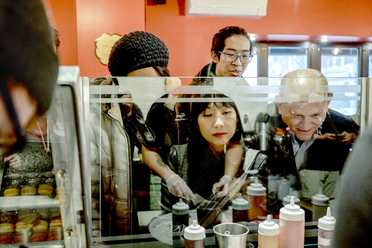 One of the Experiences offered by Airbnb in Philadelphia: a tour through the city's Chinatown neighborhood, including stops at local restaurants and shops.
