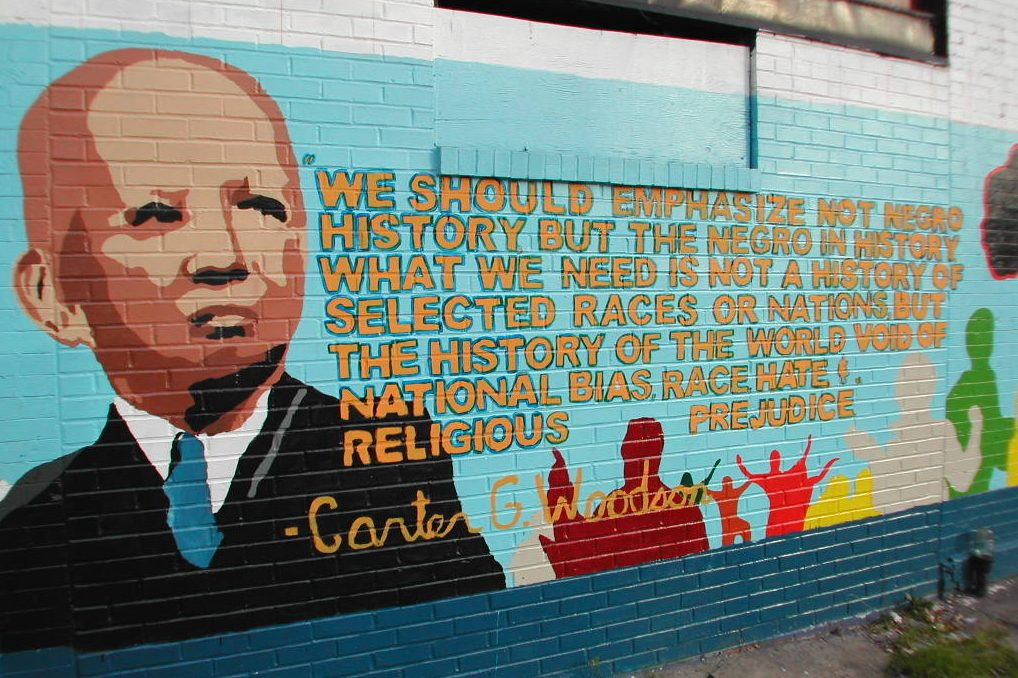A mural in Washington, D.C., pays tribute to historian Carter G. Woodson, who in 1926 created what became Black History Month.