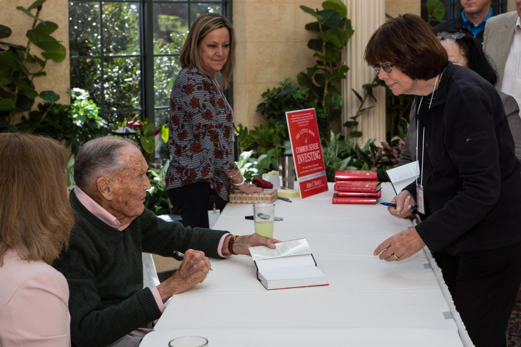"Vanguard founder John ""Jack"" Bogle signs copies of his book at the 2017 Bogleheads conference, Desmond Hotel, Philadelphia (Credit: Bogleheads.org)."