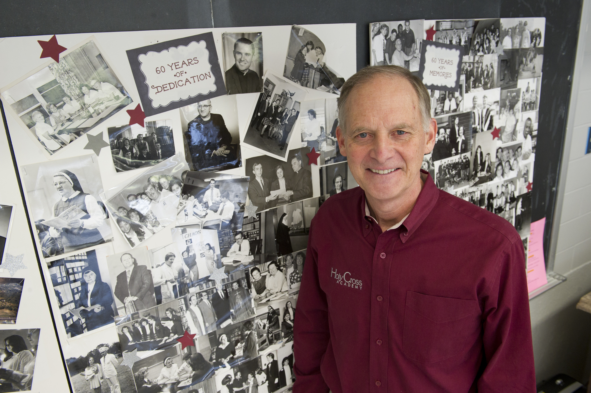 Holy Cross Academy Alumni President Dennis Murawski stands in front of a wall of vintage photographs celebrating the 60th Anniversary of the Delran, NJ based Roman Catholic high school on Wednesday, February 14, 2018. Holy Cross is the only Roman Catholic high school in Burlington County, NJ, and is closing at the end of the school year. A group of alumni, including Murawski, are working on a plan to keep it open as an independent Catholic school. Avi Steinhardt / For the Philadelphia Inquirer